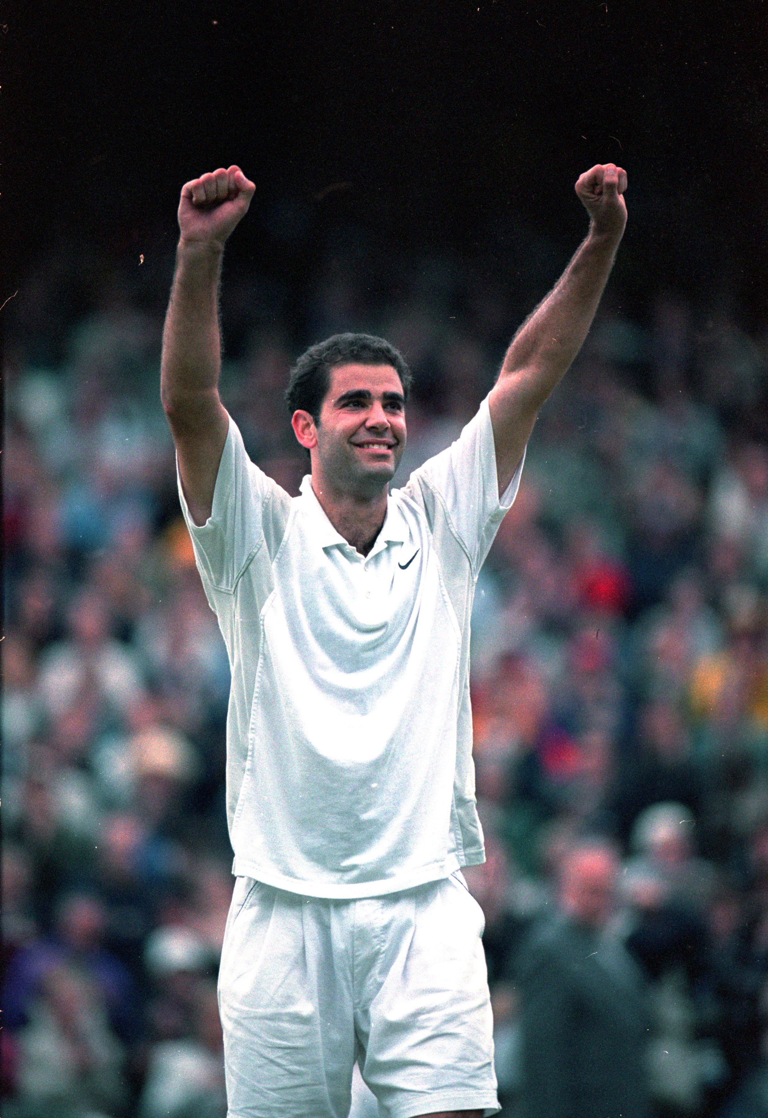 9 Jul 2000:  Pete Sampras of the USA celebrates victory in the mens final against Patrick Rafter of Australia at the Wimbledon Lawn Tennis Championship at the All England Lawn Tennis and Croquet Club, Wimbledon, London. Sampras won in four sets to claima