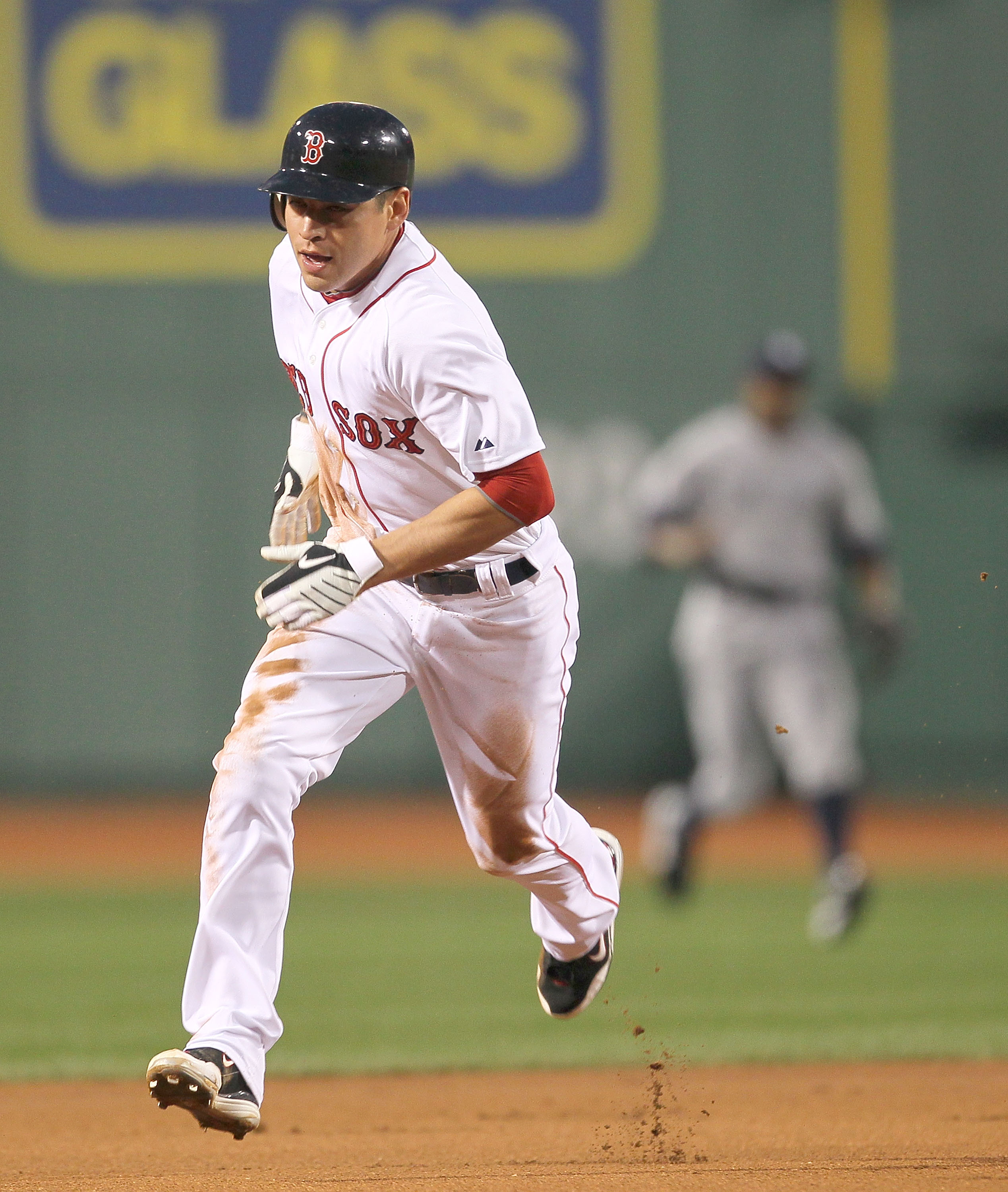 BOSTON - APRIL 06:  Jacoby Ellsbury #2 of the Boston Red Sox runs on an errant throw against the New York Yankees at Fenway Park on April 6, 2010 in Boston, Massachusetts. (Photo by Jim Rogash/Getty Images)