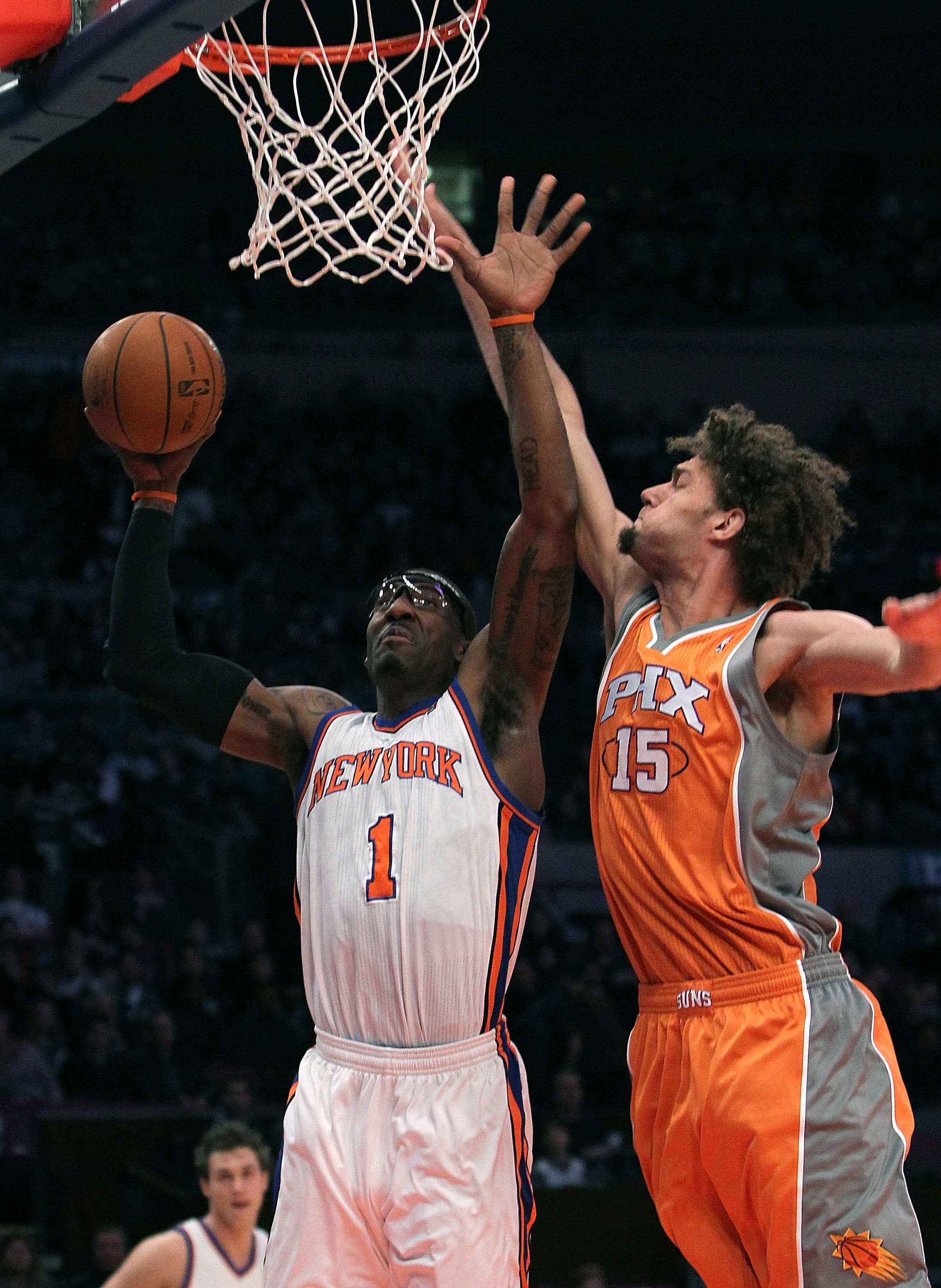 NEW YORK, NY - JANUARY 17:  Amar'e Stoudemire #1 of the New York Knicks shoots the ball against Robin Lopez #15 of the Phoenix Suns at Madison Square Garden on January 17, 2011 in New York City. NOTE TO USER: User expressly acknowledges and agrees that, b