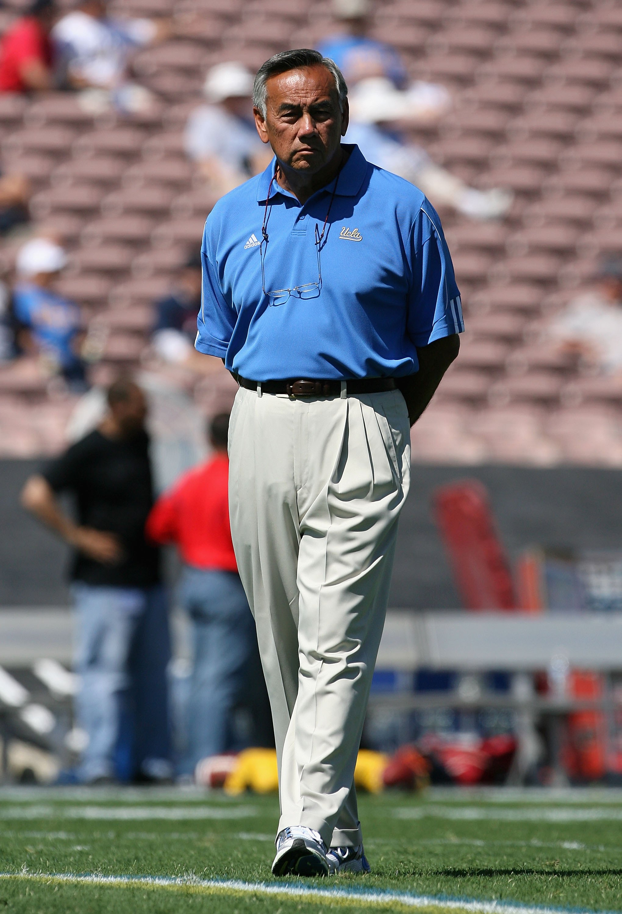 PASADENA, CA - SEPTEMBER 20:  Offensive Coordinatorm Norm Chow of the UCLA Bruins watches warm ups before the college football game against the Arizona Wildcats at the Rose Bowl on September 13, 2008 in Pasadena, California. The Wildcats defeated the Brui