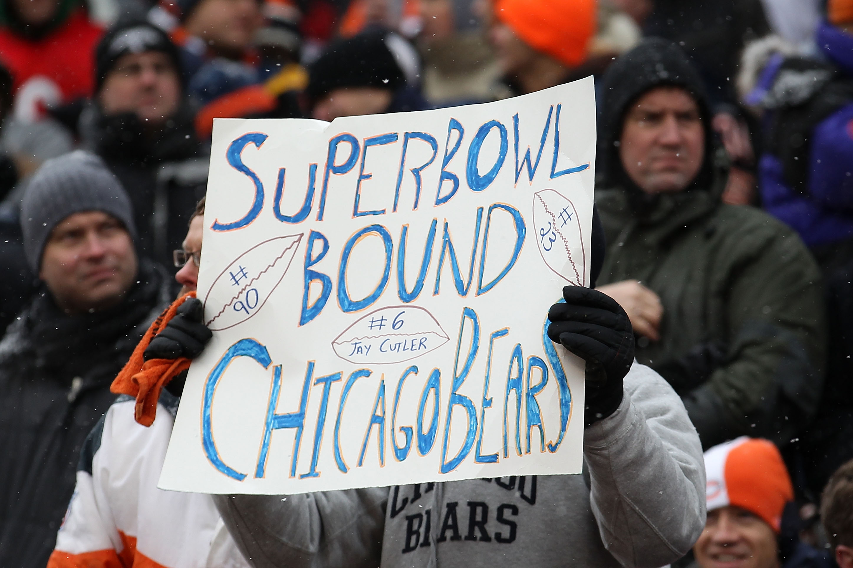 CHICAGO, IL - JANUARY 16:  A Chicago Bears fan holds up a as the Bears take on the Seattle Seahawks in the 2011 NFC divisional playoff game at Soldier Field on January 16, 2011 in Chicago, Illinois.  (Photo by Jonathan Daniel/Getty Images)