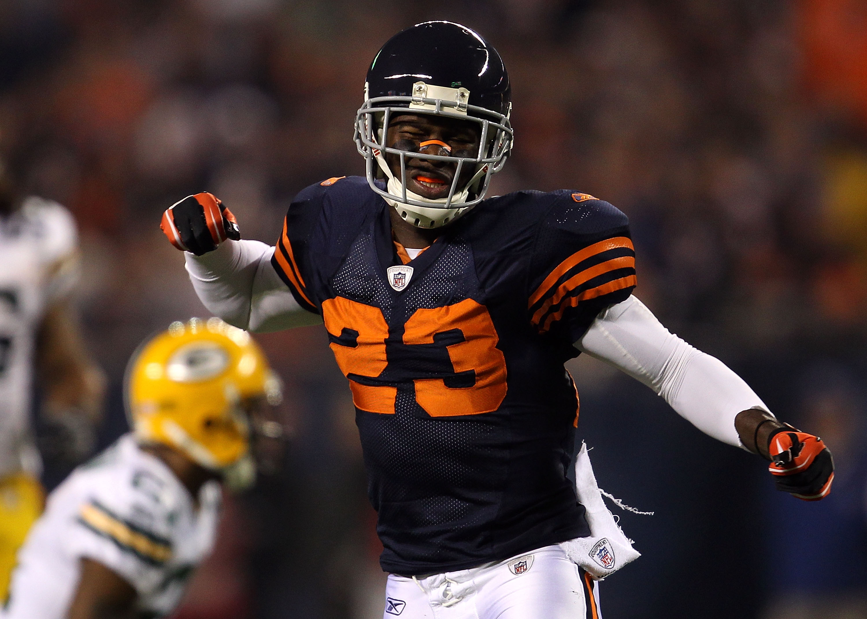 CHICAGO - SEPTEMBER 27:  Devin Hester #23 of the Chicago Bears reacts after he was interfered with on a pass play in the first quarter against Charles Woodson #21 of the Green Bay Packers at Soldier Field on September 27, 2010 in Chicago, Illinois.  (Phot