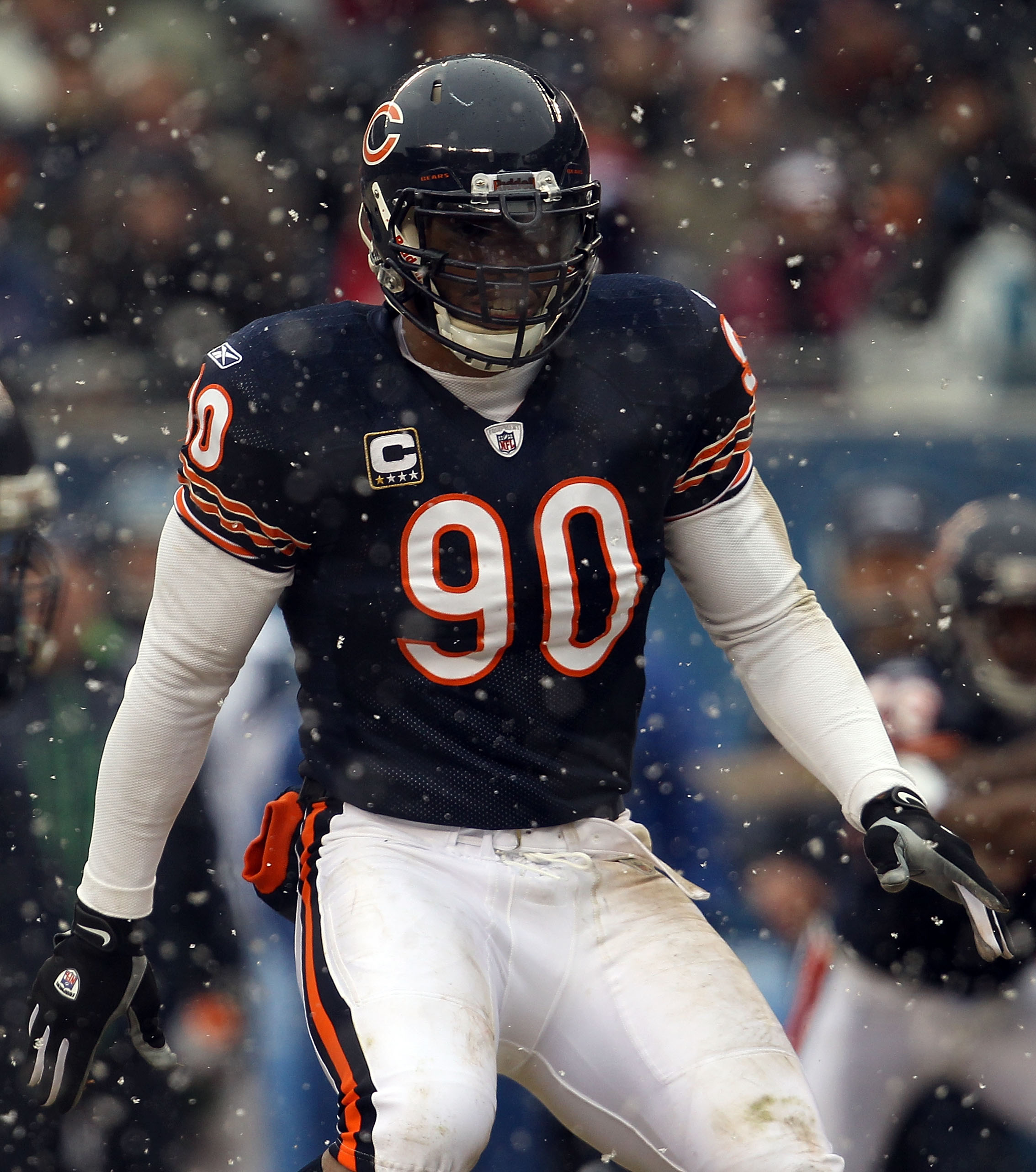 CHICAGO, IL - JANUARY 16:  Julius Peppers #90 of the Chicago Bears looks on against the Seattle Seahawks in the 2011 NFC divisional playoff game at Soldier Field on January 16, 2011 in Chicago, Illinois.  (Photo by Jonathan Daniel/Getty Images)