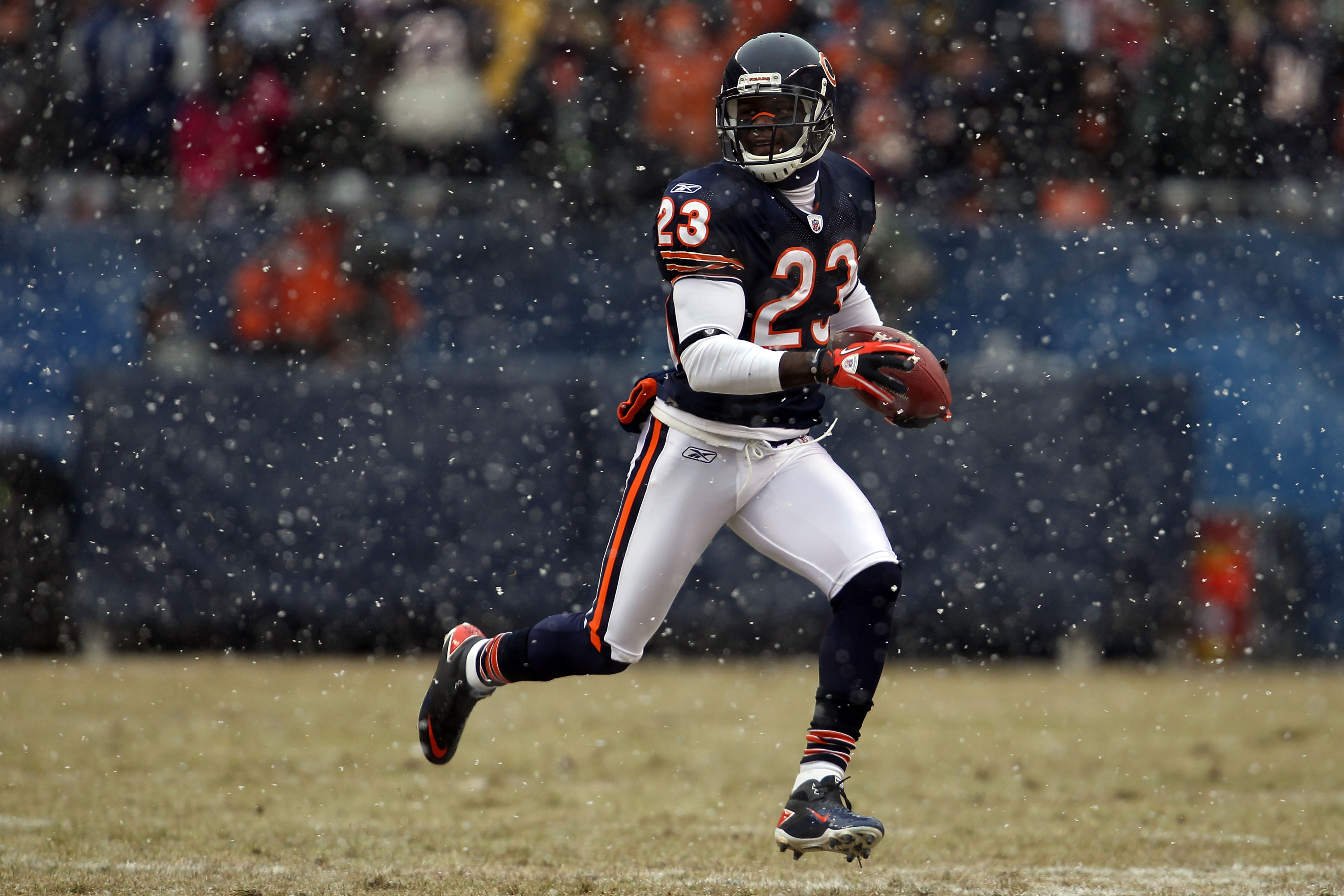 CHICAGO, IL - JANUARY 16:  Kick returner Devin Hester #23 of the Chicago Bears returns a punt in the first half against the Seattle Seahawks in the 2011 NFC divisional playoff game at Soldier Field on January 16, 2011 in Chicago, Illinois.  (Photo by Jona