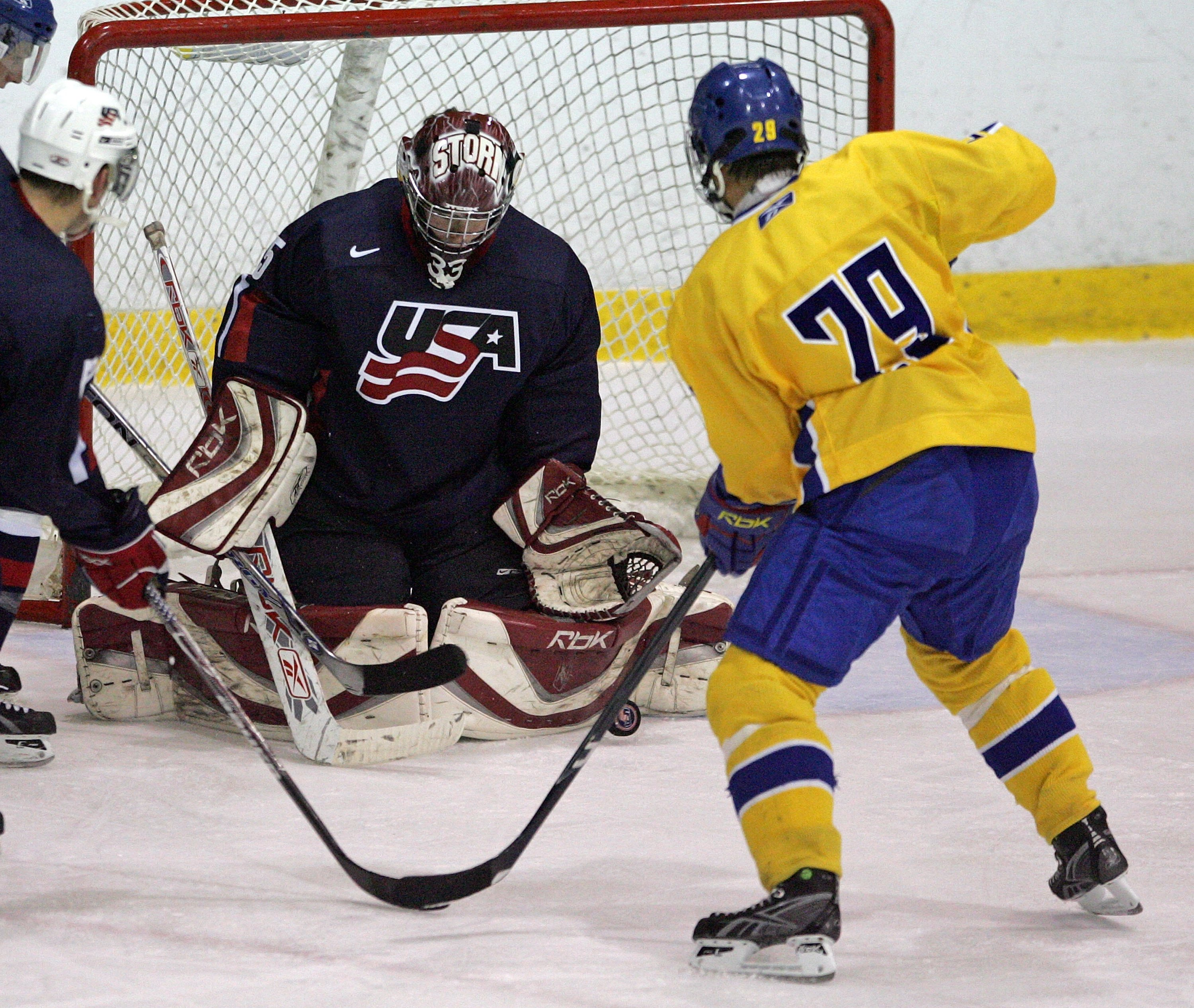 LAKE PLACID, NY - AUGUST 09:  Tom McCollum #35 of Team USA tends the net against Team Sweden at the USA Hockey National Junior Evaluation Camp on August 9, 2008 at the Olympic Center in Lake Placid, New York.  (Photo by Bruce Bennett/Getty Images)