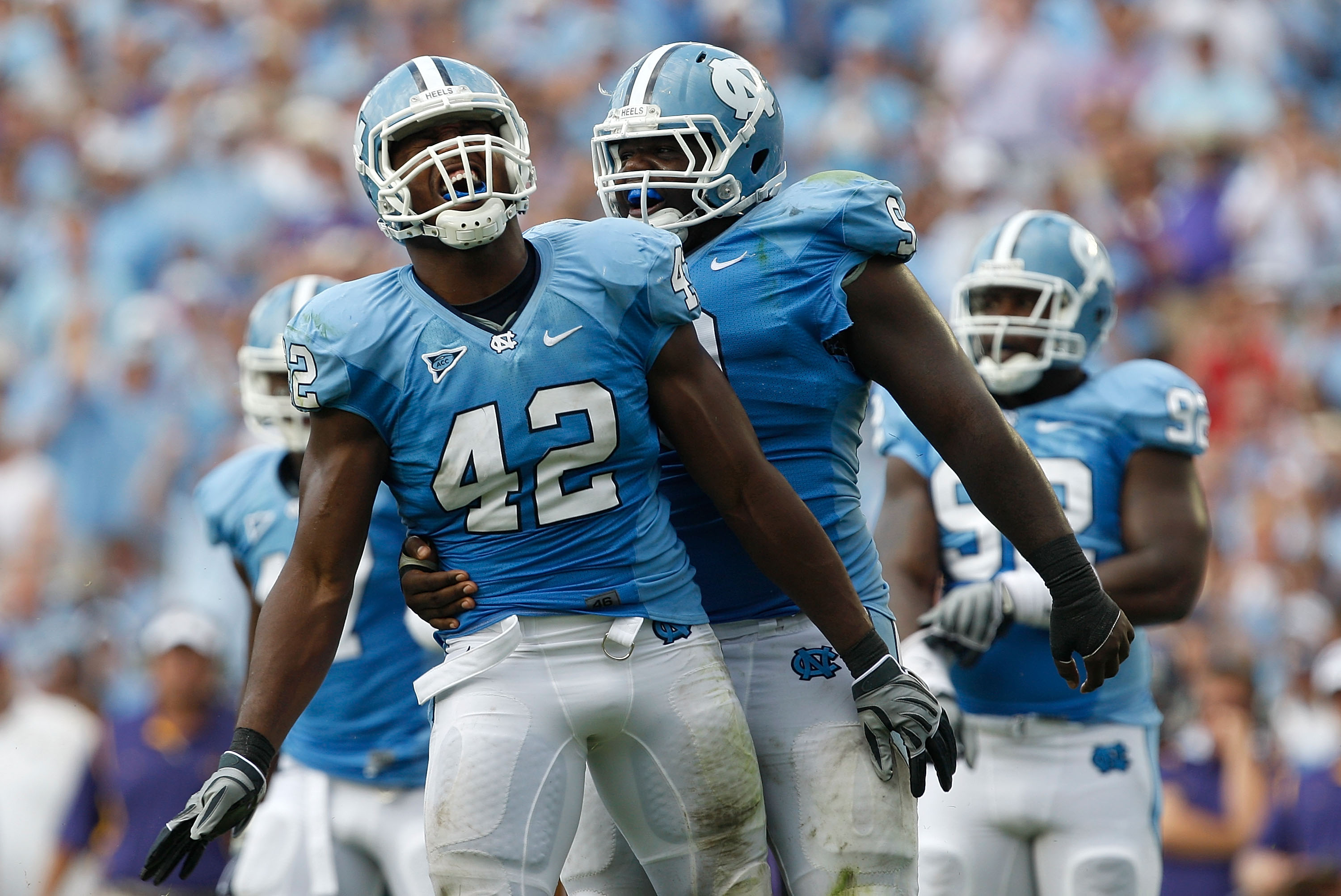 CHAPEL HILL, NC - SEPTEMBER 19:  Robert Quinn #42 of the North Carolina Tar Heels celebrates after a sack with teammate Marvin Austin #9 against the East Carolina Pirates at Kenan Stadium on September 19, 2009 in Chapel Hill, North Carolina.  (Photo by St