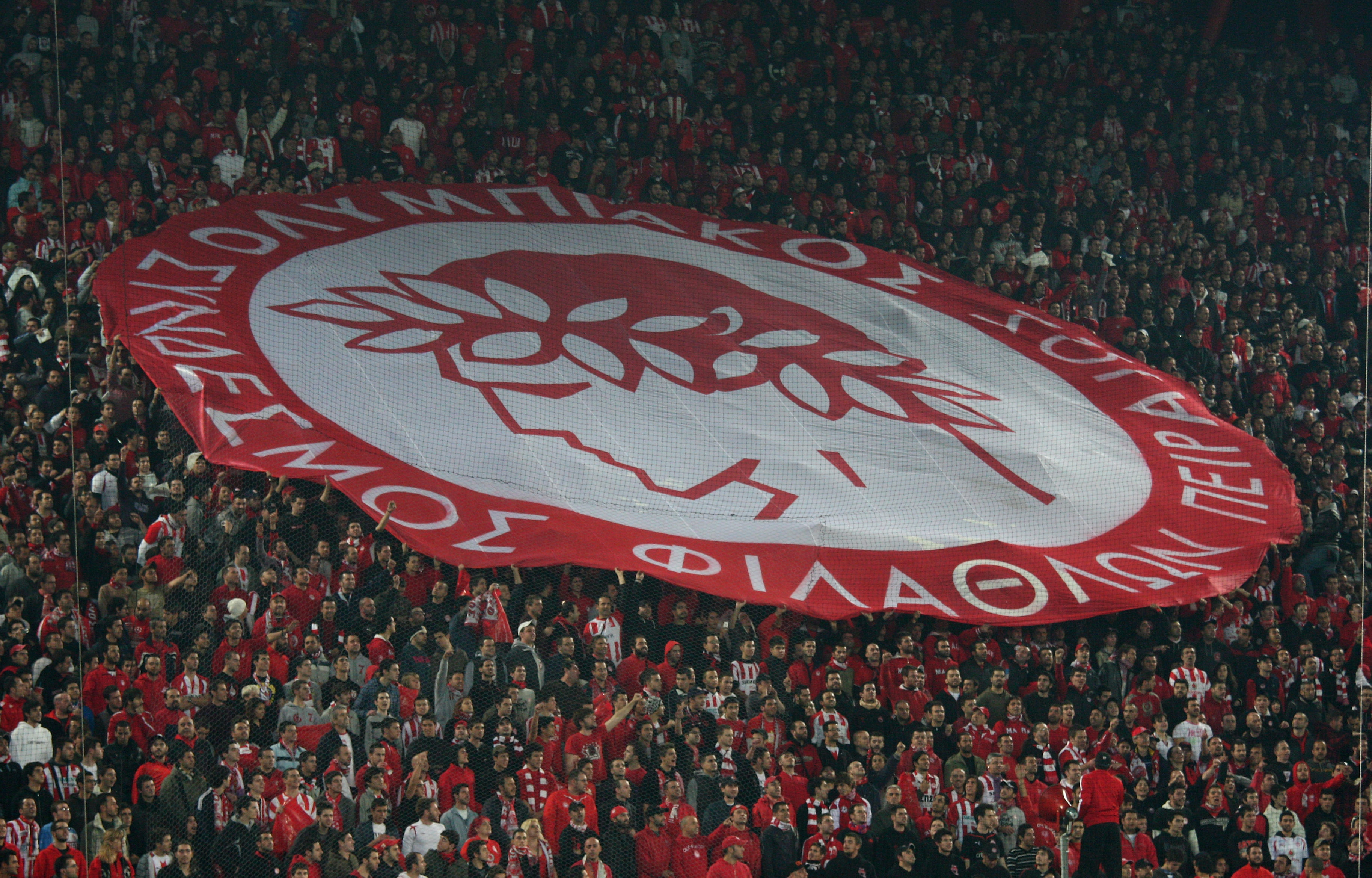ATHENS, GREECE - DECEMBER 09:  Olympiakos fans during the UEFA Champions League Group H match between Olympiakos and Arsenal at the Georgios Karaiskakis Stadium on December 9, 2009 in Athens, Greece.  (Photo by Richard Heathcote/Getty Images)
