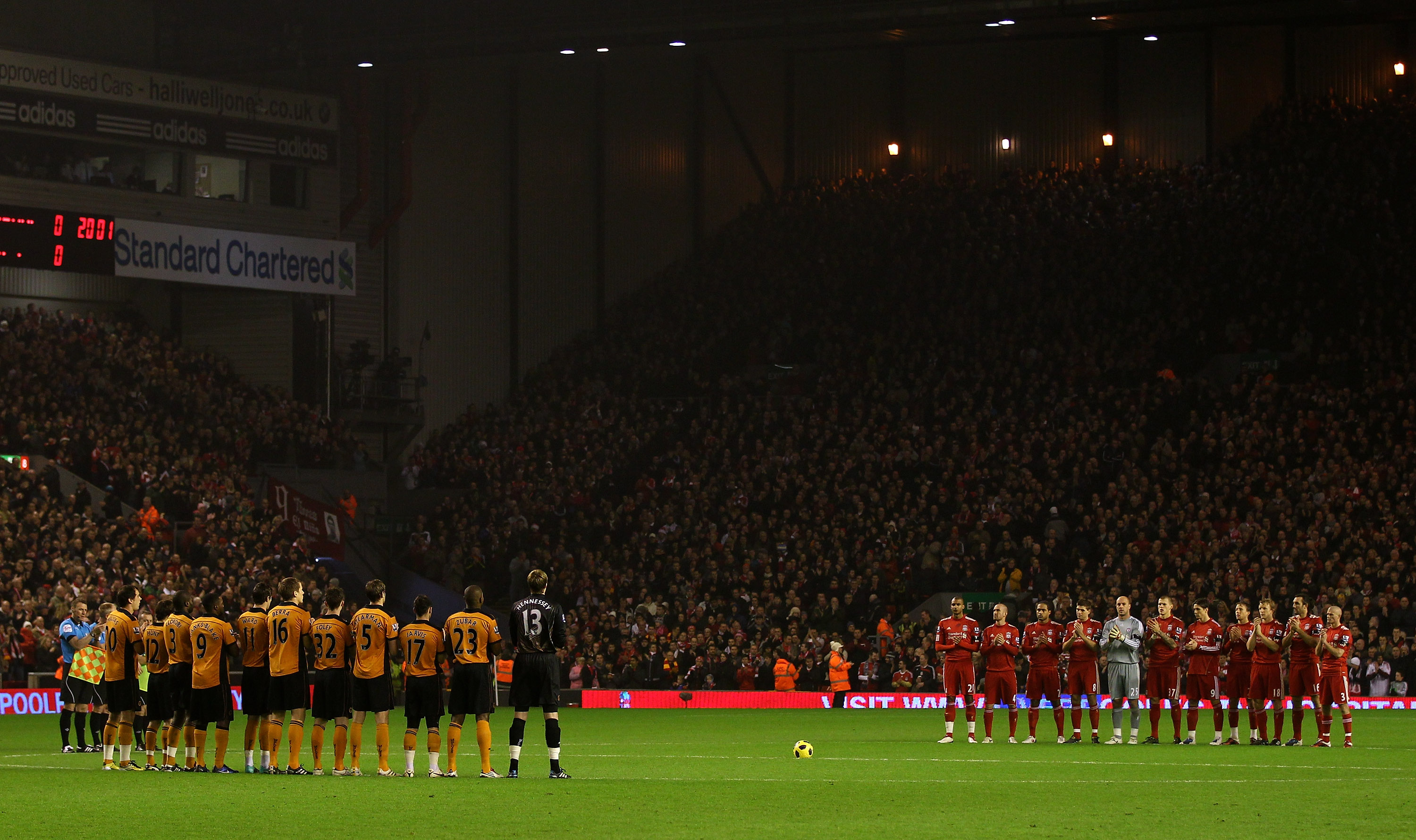 LIVERPOOL, ENGLAND - DECEMBER 29:  The Liverpool and Wolves players applaud to honour the memory of ex Liverpool player Avi Cohen who died this week from injuries sustained in a motorcycle accident, prior to the Barclays Premier League match between Liver