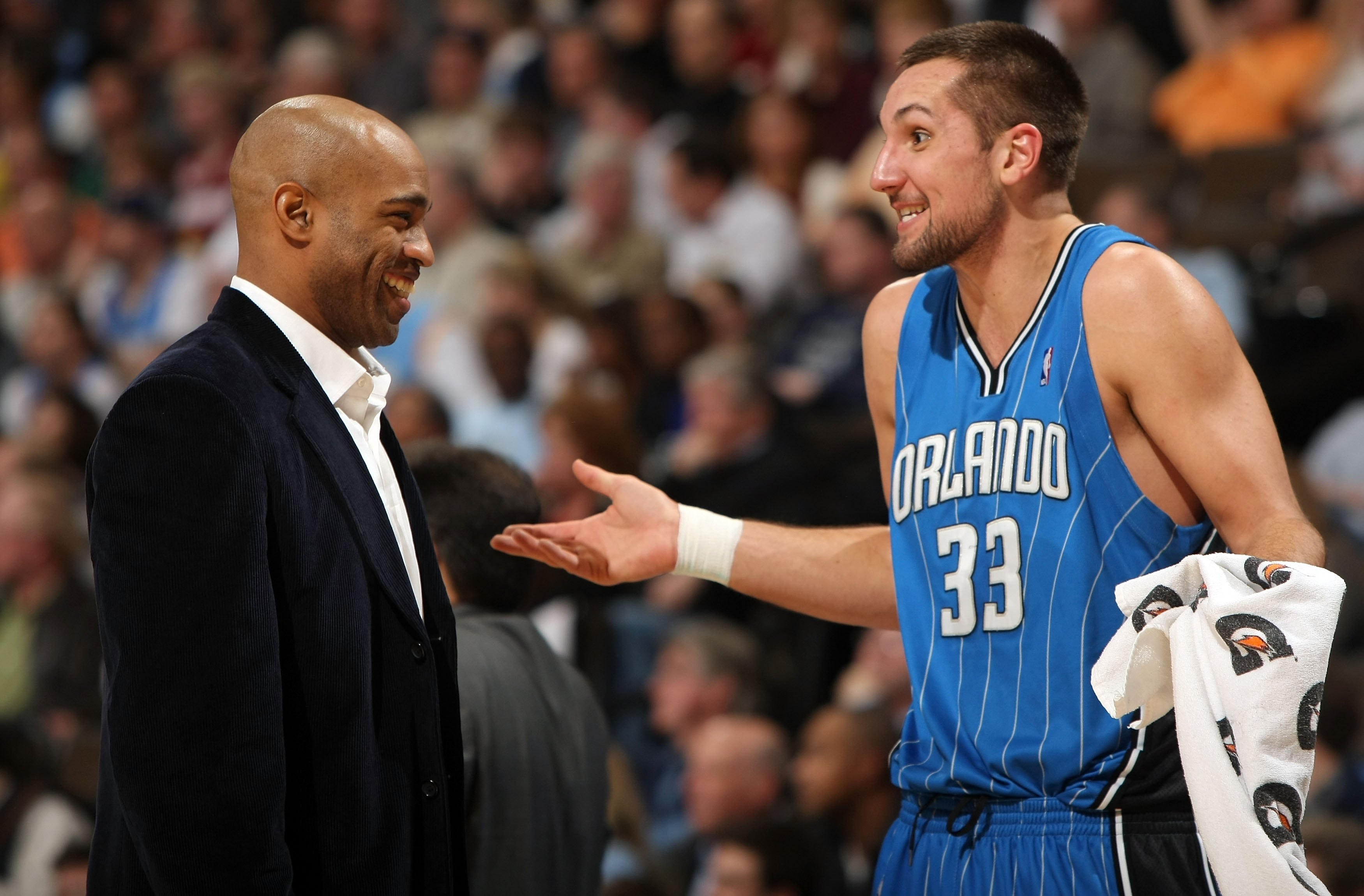 DENVER - JANUARY 13:  Ryan Anderson #33 of the Orlando Magic talks with an injured Vince Carter during a time out against the Denver Nuggets during NBA action at Pepsi Center on January 13, 2010 in Denver, Colorado. The Nuggets defeated the Magic 115-97.