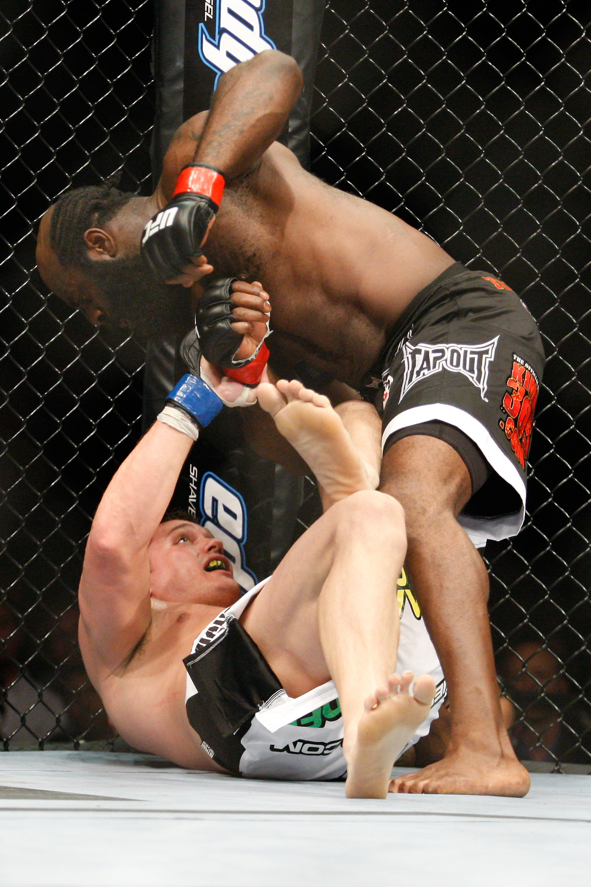 MONTREAL- MAY 8: Kimbo Slice (top) punches Matt Mitrione in their heavyweight bout at UFC 113 at Bell Centre on May 8, 2010 in Montreal, Quebec, Canada.  (Photo by Richard Wolowicz/Getty Images)