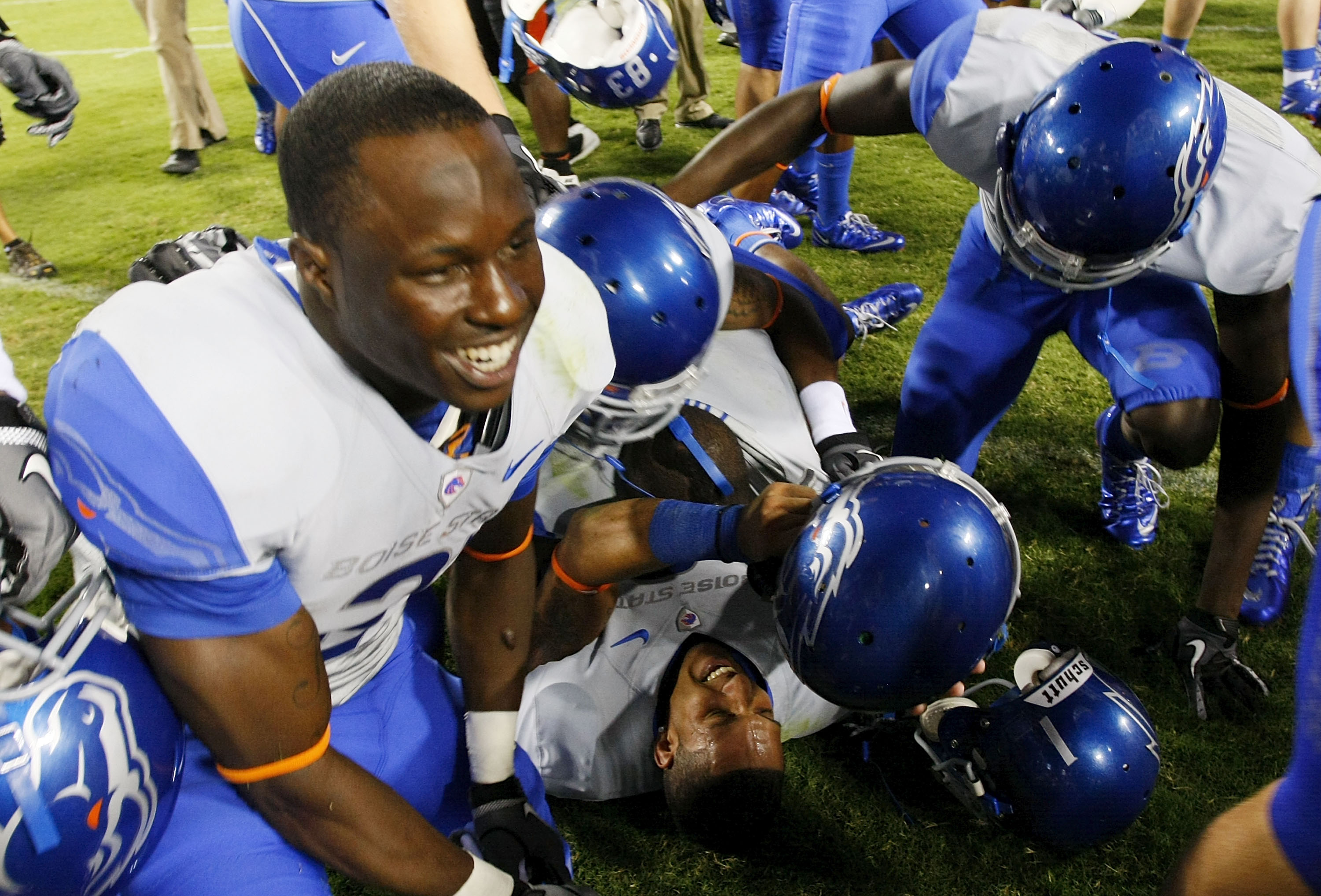 LANDOVER, MD - SEPTEMBER 06:  Wide reciever Austin Pettis (bottom) of the Boise State Broncos is mobbed by teammates after the Broncos defeated the Virginia Tech Hokies 33-30  at FedExField on September 6, 2010 in Landover, Maryland.  (Photo by Geoff Burk