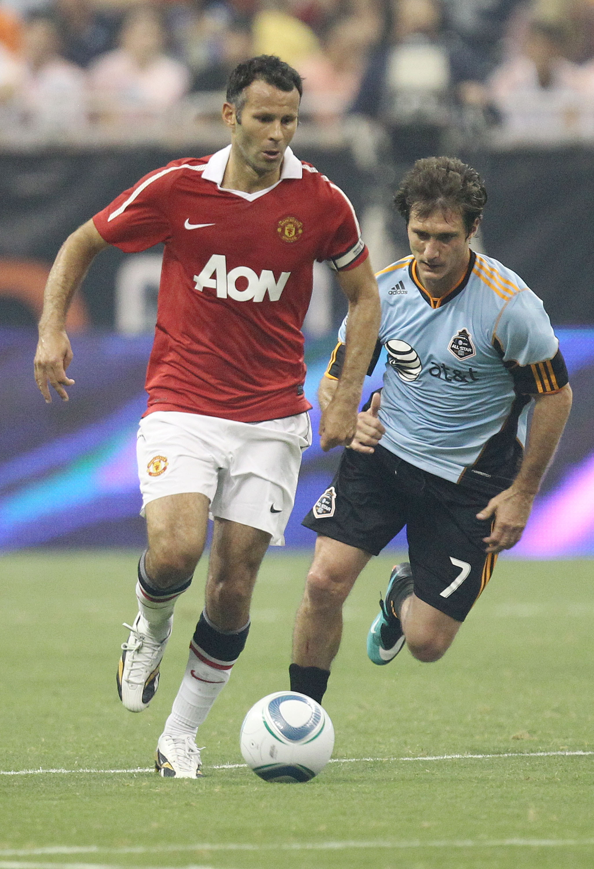 HOUSTON - JULY 28:  Ryan Giggs controls the ball during the MLS All Star Game at Reliant Stadium on July 28, 2010 in Houston, Texas.  (Photo by Ronald Martinez/Getty Images)