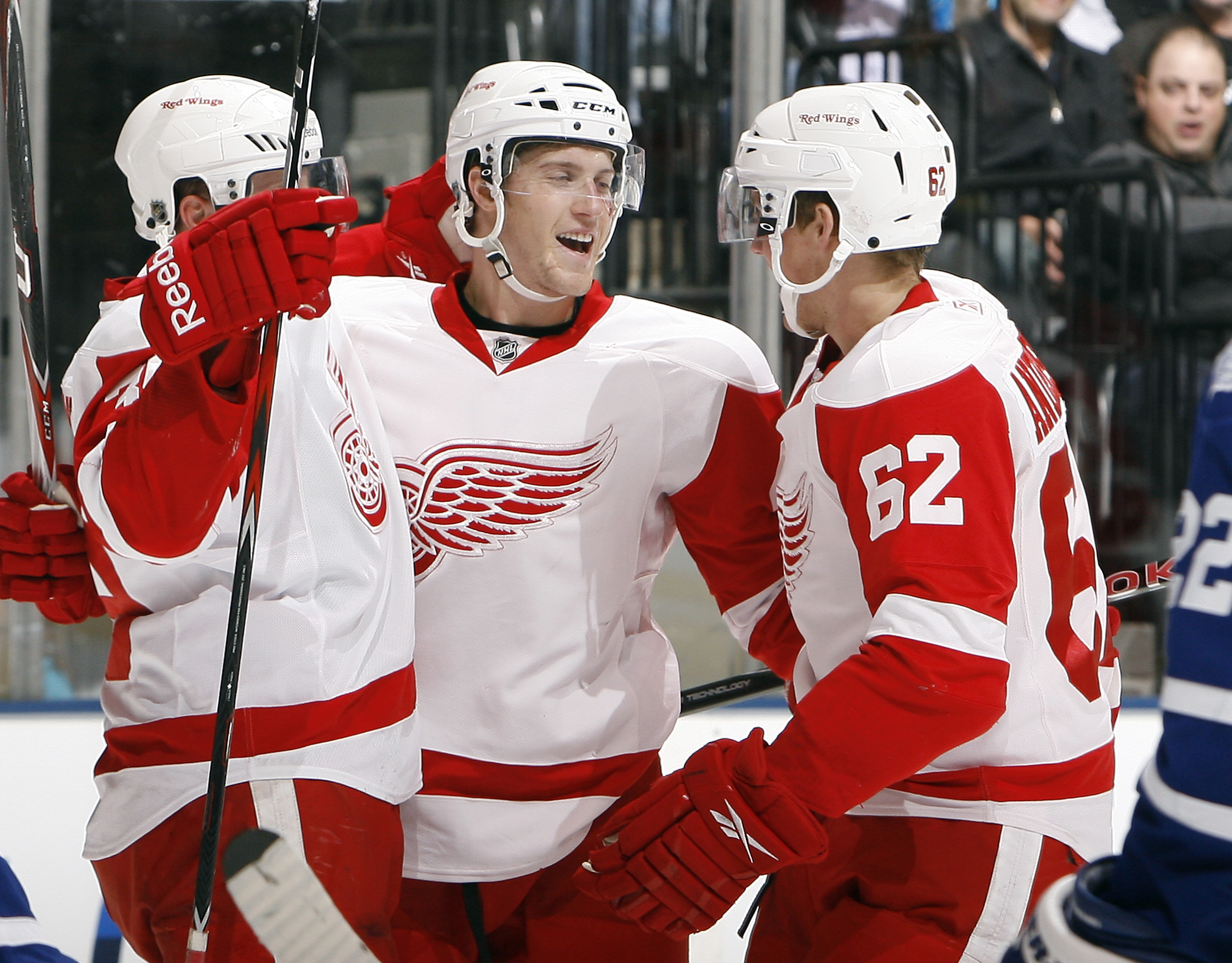 TORONTO - OCTOBER 2:  Jan Mursak #39, Cory Emmerton #48, and Joakim Andersson #62 of the Detroit Red Wings celebrate a goal against the Toronto Maple Leafs during a preseason NHL game at the Air Canada Centre October 2, 2010 in Toronto, Ontario, Canada. (