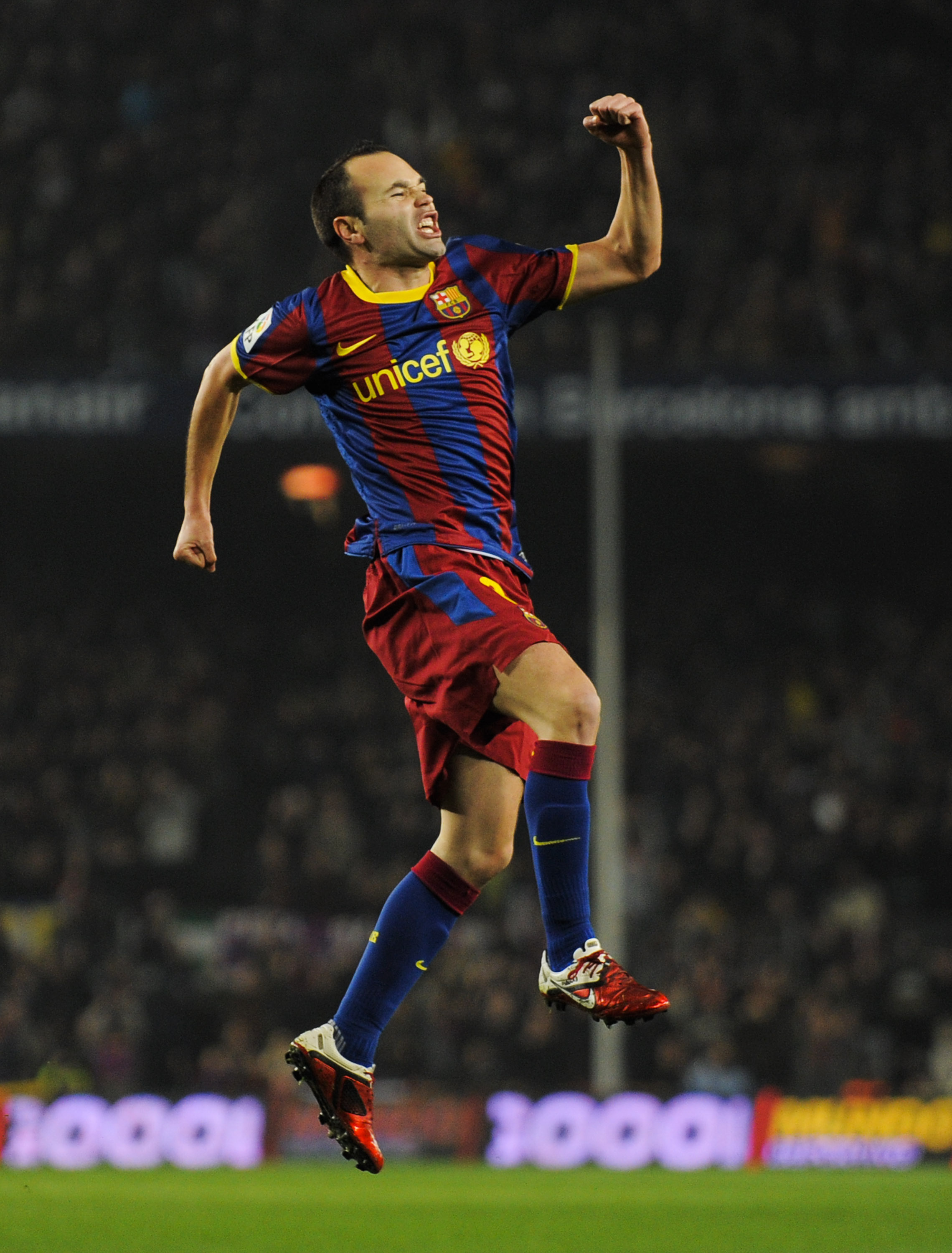 BARCELONA, SPAIN - JANUARY 16:  Andres Iniesta of FC Barcelona celebrates after scoring his side's first goal during the La Liga match between FC Barcelona and Malaga at Nou Camp on January 16, 2011 in Barcelona, Spain.  (Photo by David Ramos/Getty Images