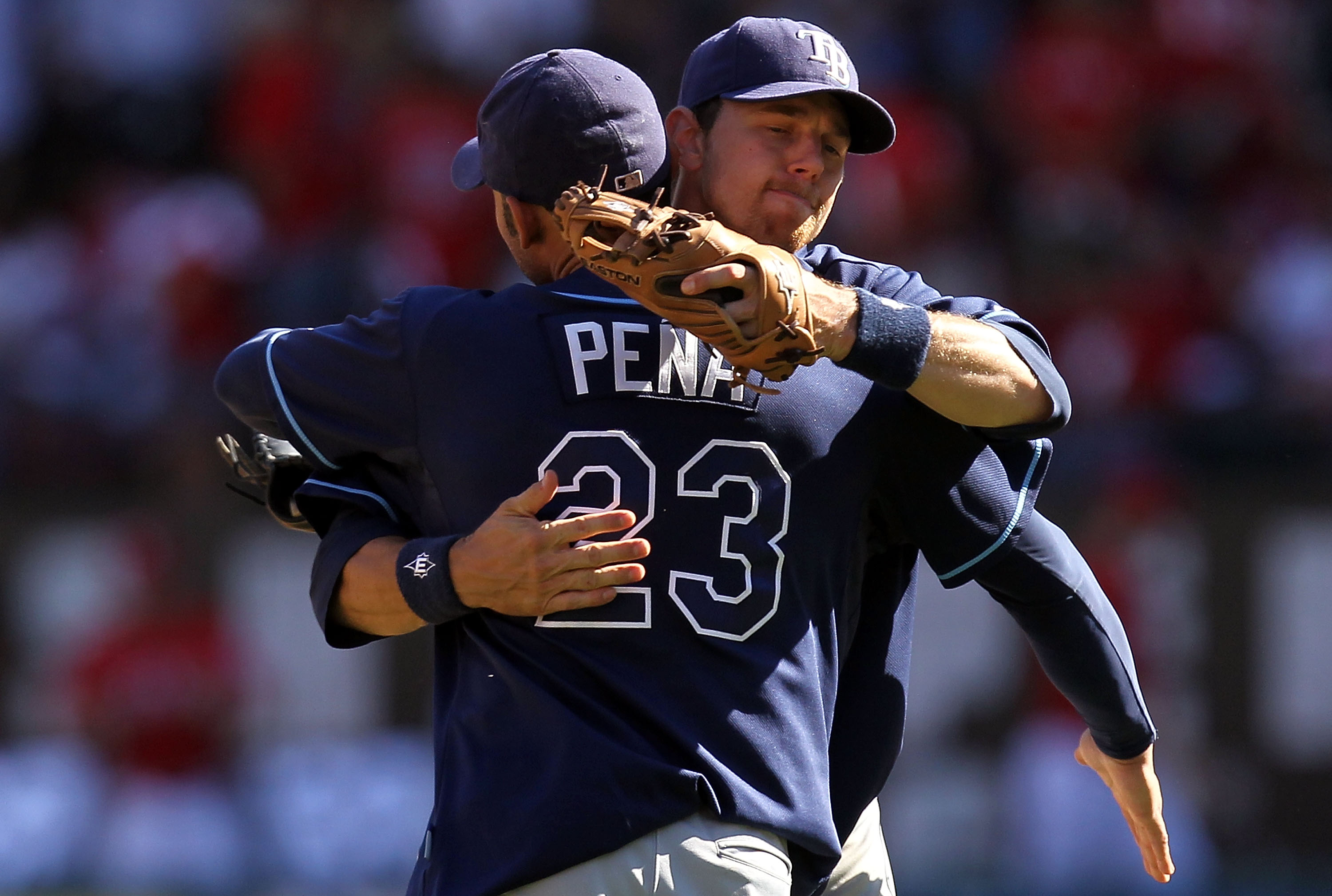ARLINGTON, TX - OCTOBER 10:  Carlos Pena #23 hugs Ben Zobrist #18 of the Tampa Bay Rays after a 5-2 win against the Texas Rangers during game 4 of the ALDS at Rangers Ballpark in Arlington on October 10, 2010 in Arlington, Texas.  (Photo by Ronald Martine