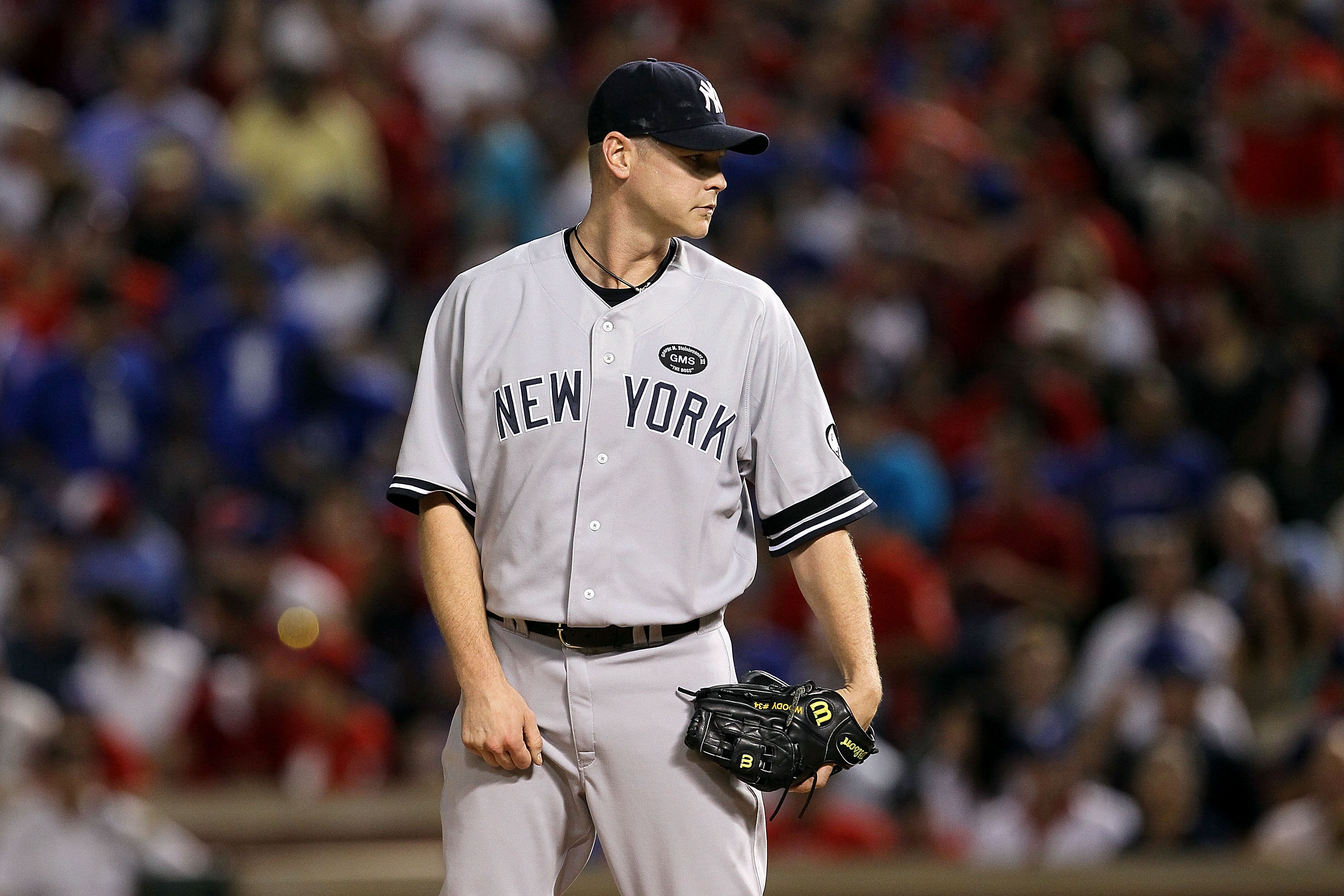 ARLINGTON, TX - OCTOBER 22:  Kerry Wood #39 of the New York Yankees gets set to throw a pitch against the Texas Rangers in Game Six of the ALCS during the 2010 MLB Playoffs at Rangers Ballpark in Arlington on October 22, 2010 in Arlington, Texas. The Rang
