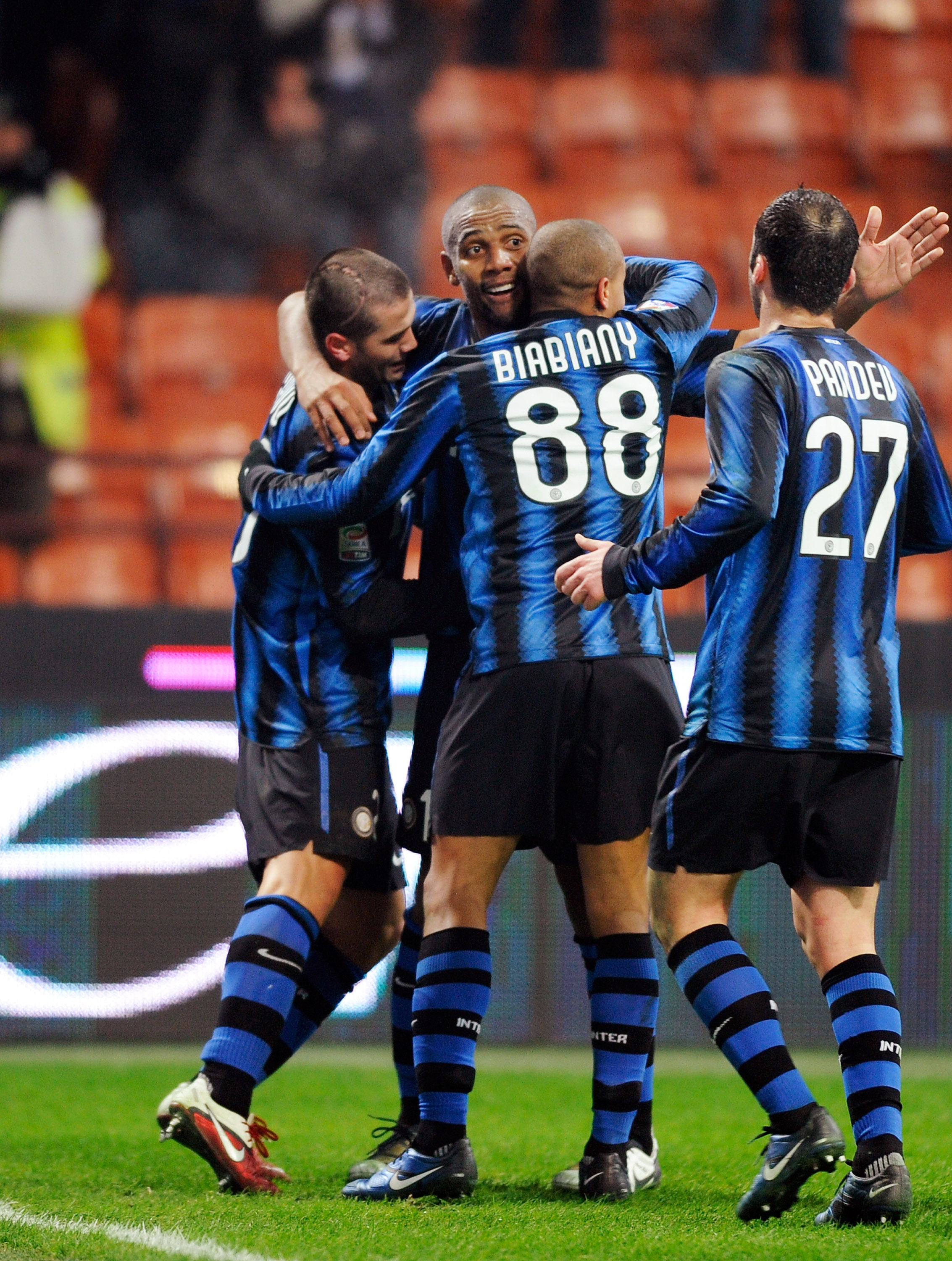 MILAN, ITALY - JANUARY 19:  Cristian Chivu (L) of Inter Milan celebrates scoring the third goal during the Serie A match between Inter and Cesena at Stadio Giuseppe Meazza on January 19, 2011 in Milan, Italy.  (Photo by Claudio Villa/Getty Images)