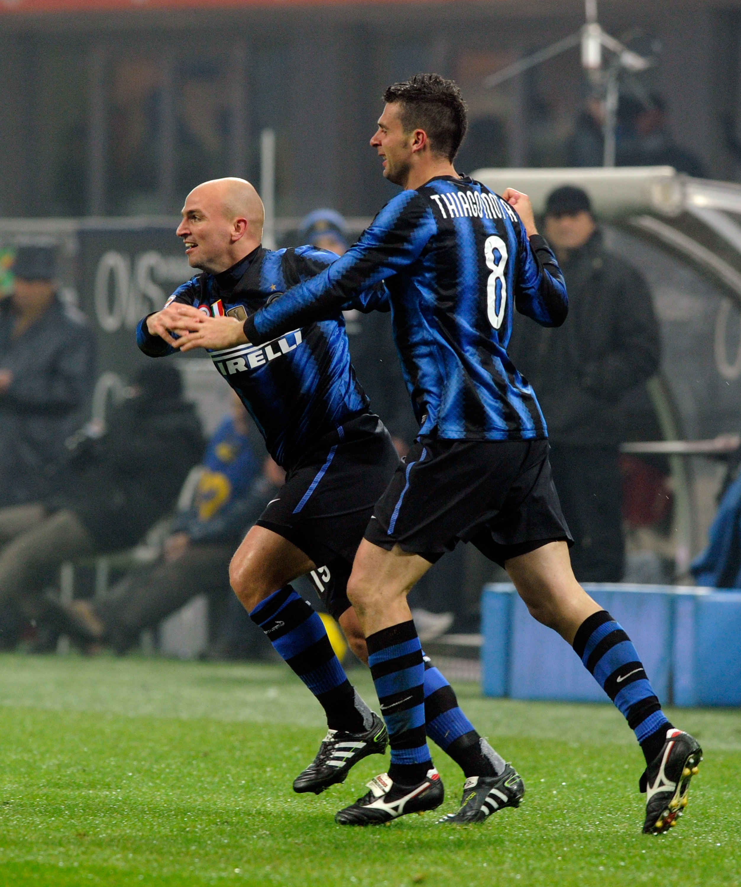 MILAN, ITALY - JANUARY 06:  Esteban Cambiasso (L) and Thiago Motta of FC Internazionale Milano celebrate scoring the third goal during the Serie A match between Inter and Napoli at Stadio Giuseppe Meazza on January 6, 2011 in Milan, Italy.  (Photo by Clau