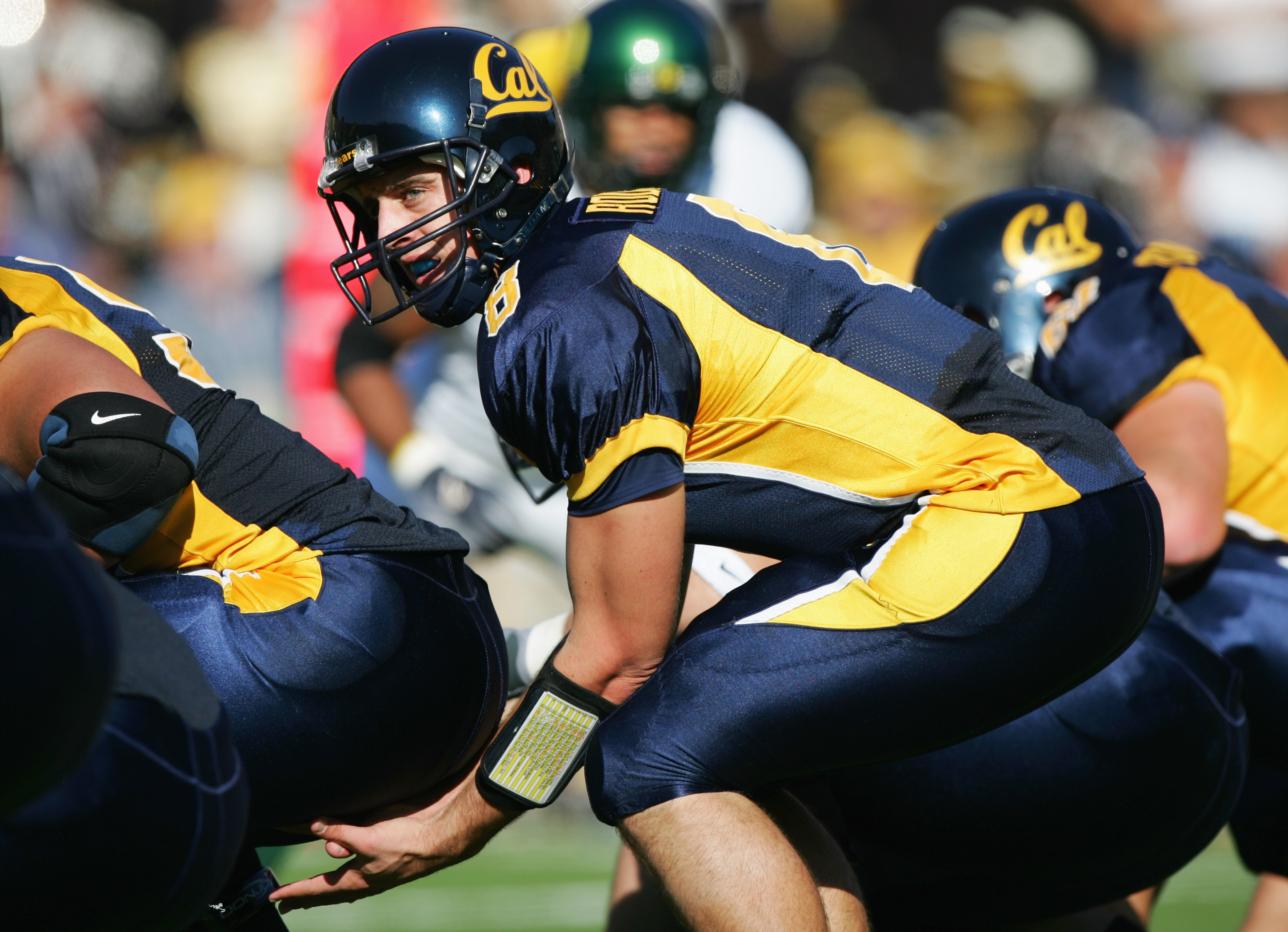 BERKELEY, CA - NOVEMBER 6:  Aaron Rodgers #8 of the California Golden Bears lines up under center during the game against the Oregon Ducks at Memorial Stadium on November 6, 2004 in Berkeley, California. The Bears defeated the Ducks 28-27.  (Photo by Jed