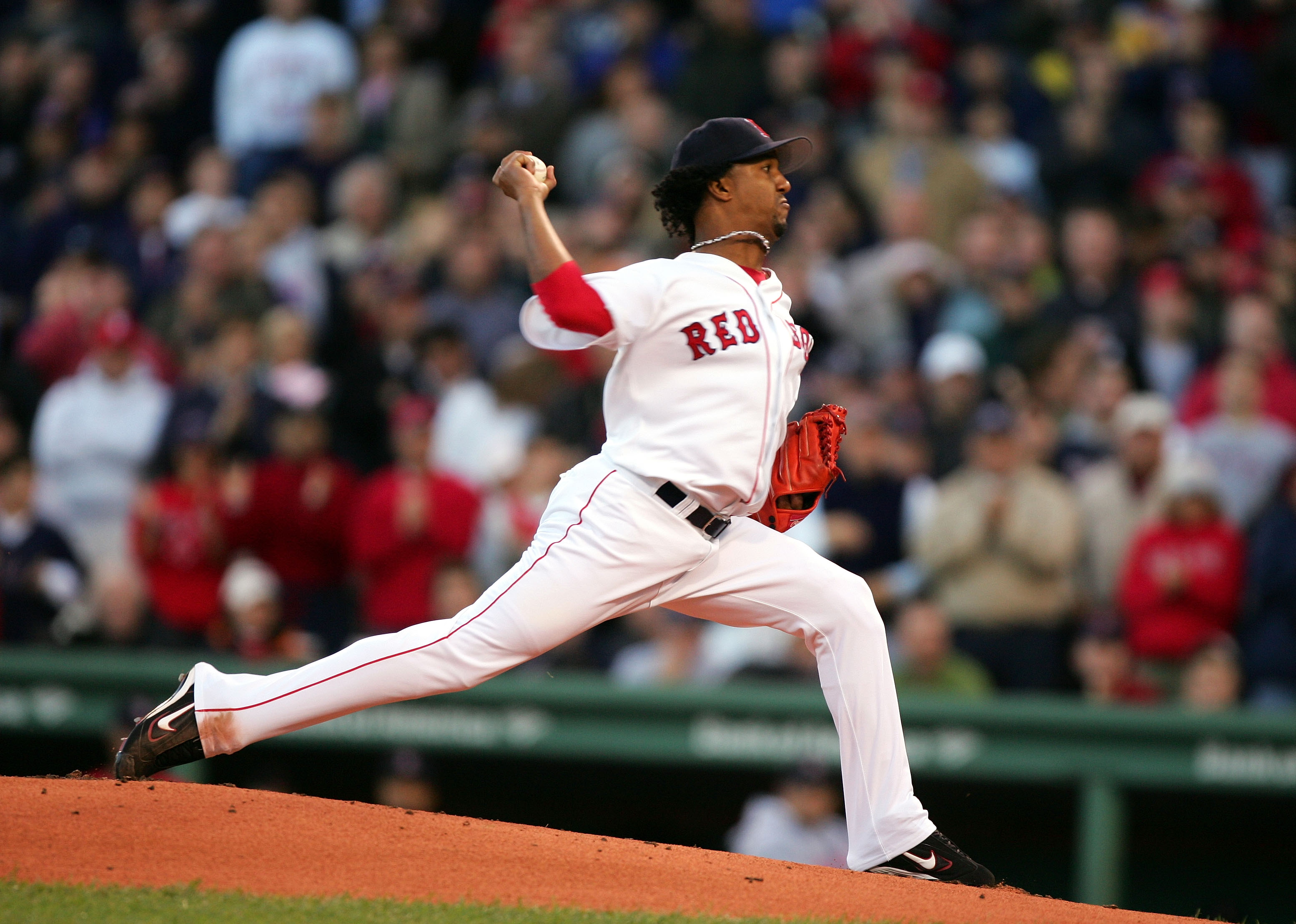 BOSTON - OCTOBER 18:  Pitcher Pedro Martinez #45 of the Boston Red Sox throws a pitch against the New York Yankees in the first inning during game five of the American League Championship Series on October 18, 2004 at Fenway Park in Boston, Massachusetts.