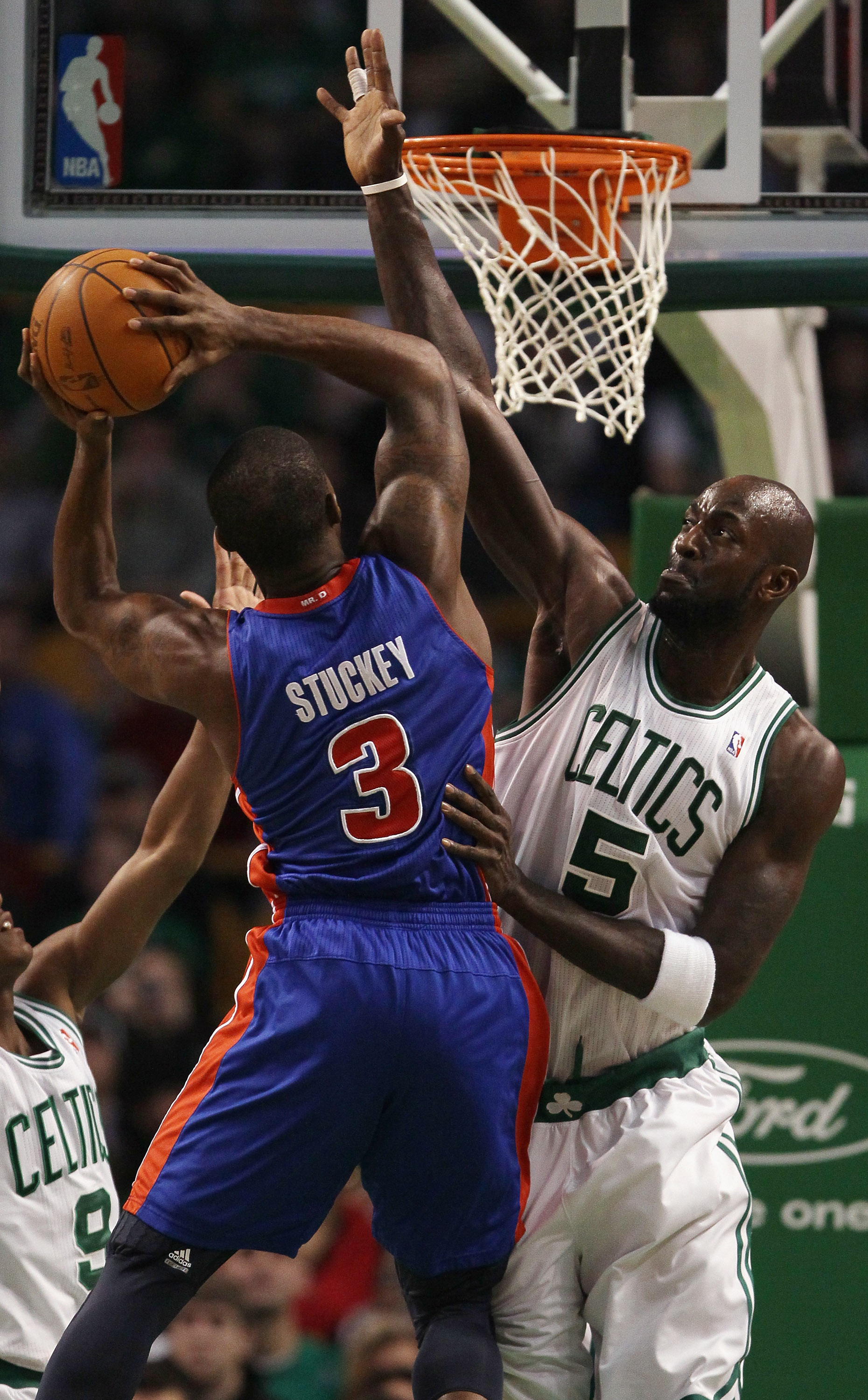BOSTON, MA - JANUARY 19:  Kevin Garnett #5 of the Boston Celtics blocks as Rodney Stuckey #3 of the Detroit Pistons takes a shot on January 19, 2011 at the TD Garden in Boston, Massachusetts.  NOTE TO USER: User expressly acknowledges and agrees that, by