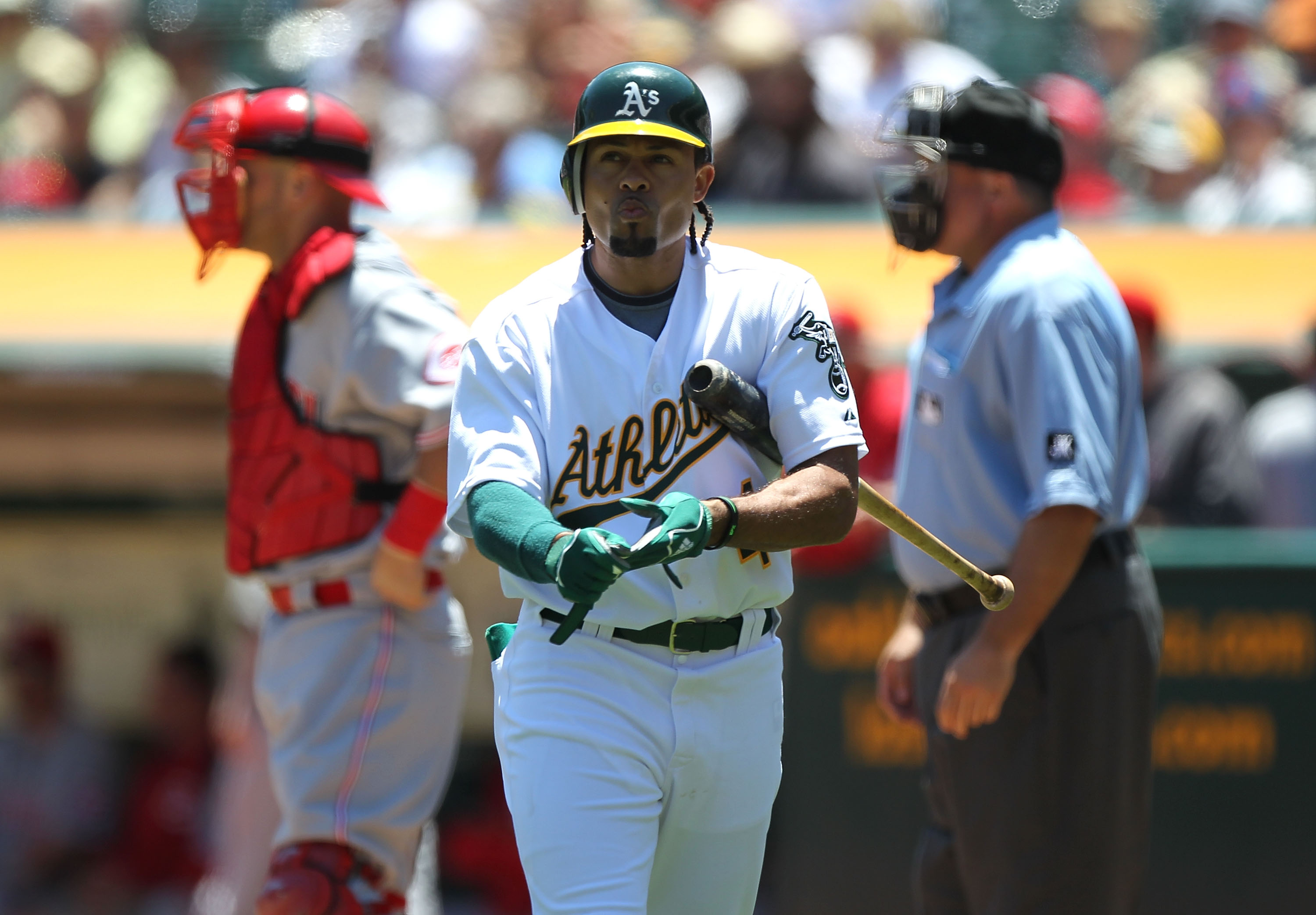 OAKLAND, CA - JUNE 23:  Coco Crisp #4 of the Oakland Athletics strikes out against the Cincinnati Reds in the first inning during an MLB game at the Oakland-Alameda County Coliseum on June 23, 2010 in Oakland, California.  (Photo by Jed Jacobsohn/Getty Im