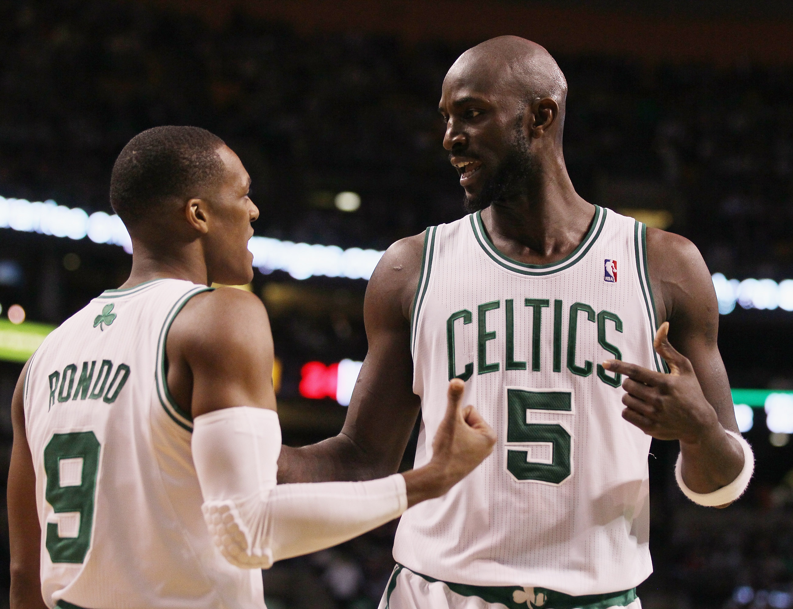 BOSTON, MA - JANUARY 17:  Kevin Garnett #5 and Rajon Rondo #9 of the Boston Celtics talk before the Orlando Magic pass the ball in bounds on January 17, 2011 at the TD Garden in Boston, Massachusetts. The Celtics defeated the Magic 109-106.  NOTE TO USER: