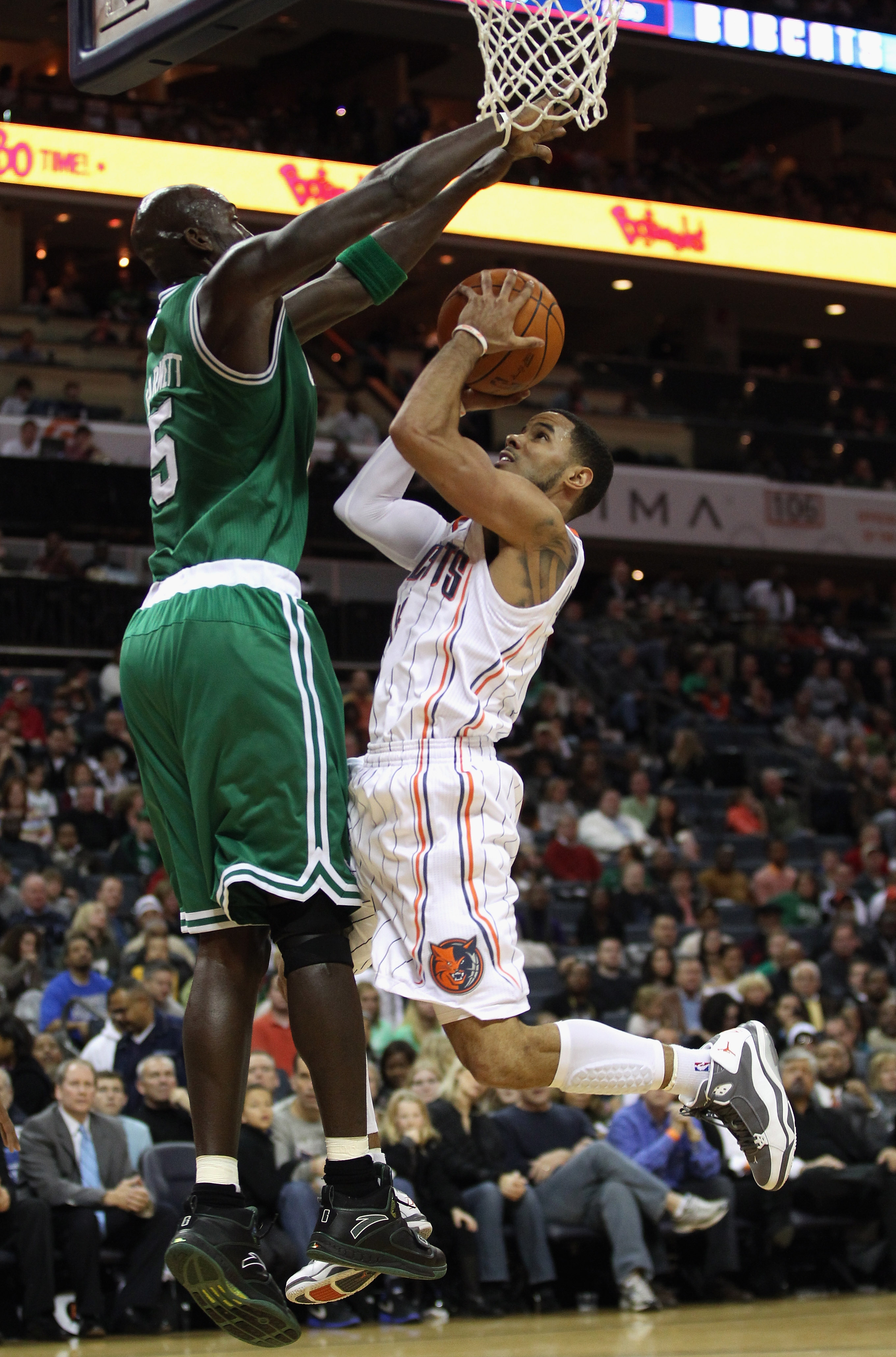 CHARLOTTE, NC - DECEMBER 11:  Kevin Garnett #5 of the Boston Celtics tries to stop D.J. Augustin #14 of the Charlotte Bobcats during their game at Time Warner Cable Arena on December 11, 2010 in Charlotte, North Carolina. NOTE TO USER: User expressly ackn