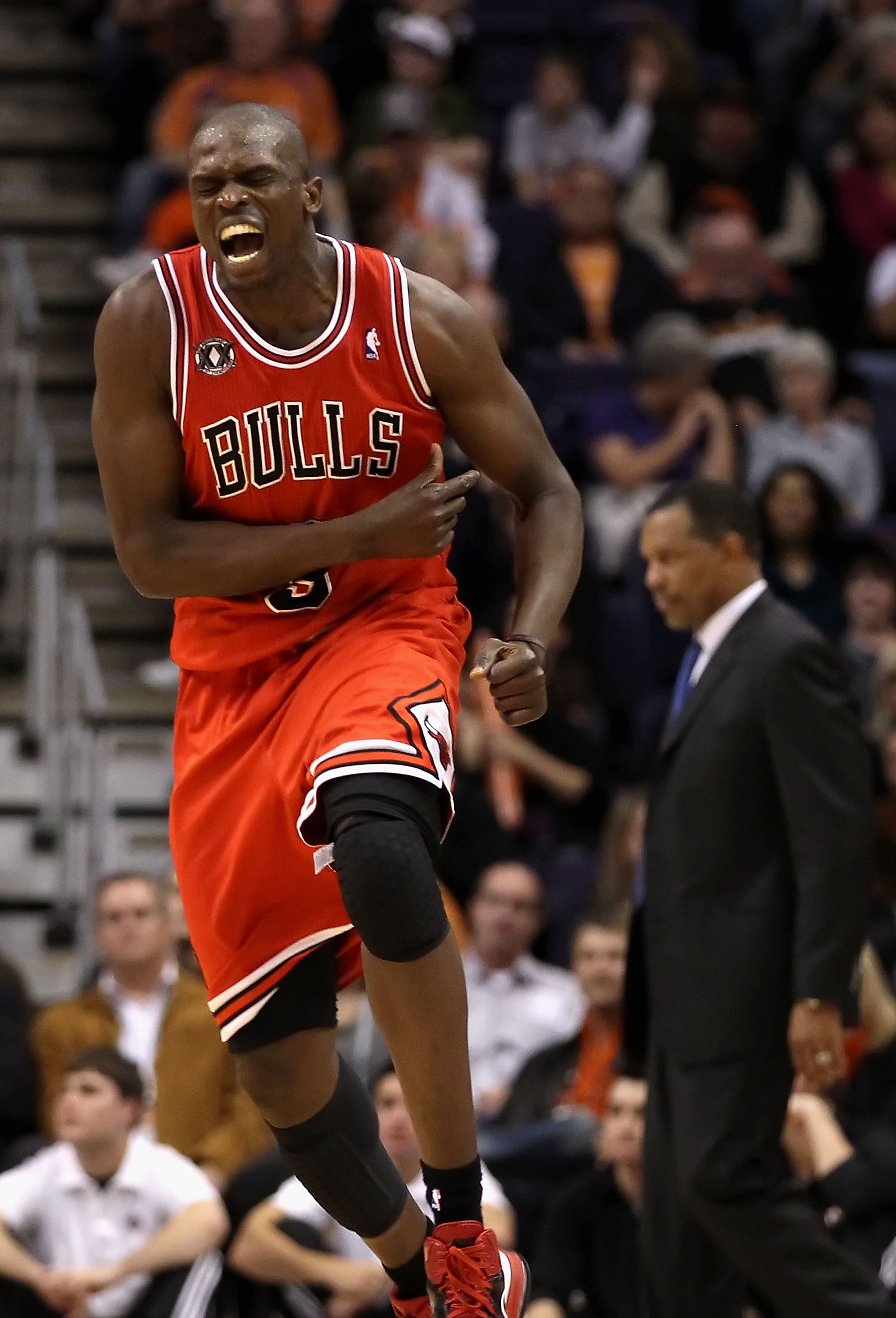 PHOENIX - NOVEMBER 24:  Luol Deng #9 of the Chicago Bulls celebrates after scoring against the Phoenix Suns late in overtime of the NBA game at US Airways Center on November 24, 2010 in Phoenix, Arizona. NOTE TO USER: User expressly acknowledges and agree