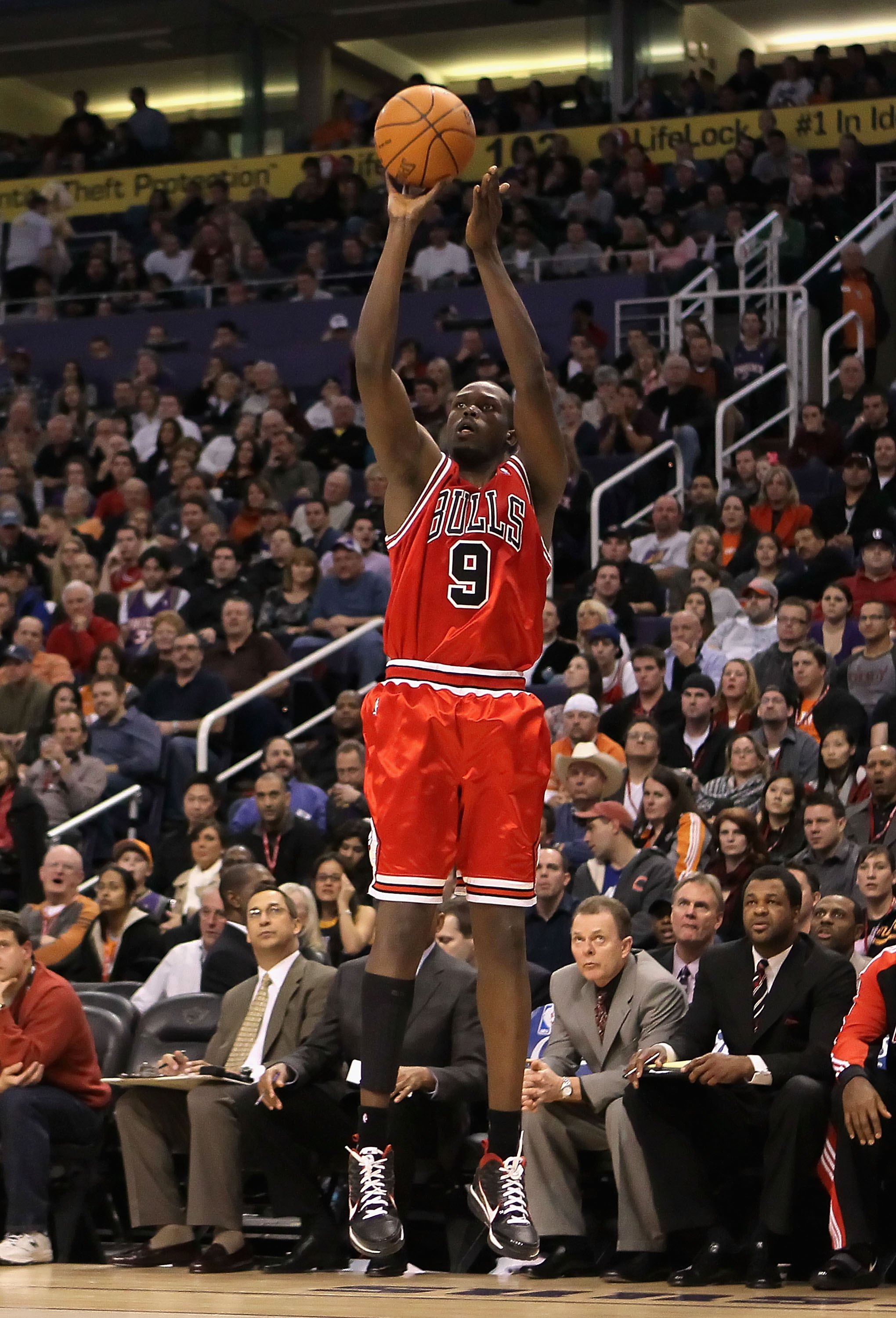 PHOENIX - JANUARY 22:  Luol Deng #9 of the Chicago Bulls puts up a three point shot against the Phoenix Suns during the NBA game at US Airways Center on January 22, 2010 in Phoenix, Arizona. The Bulls defeated the Suns 115-104.  NOTE TO USER: User express