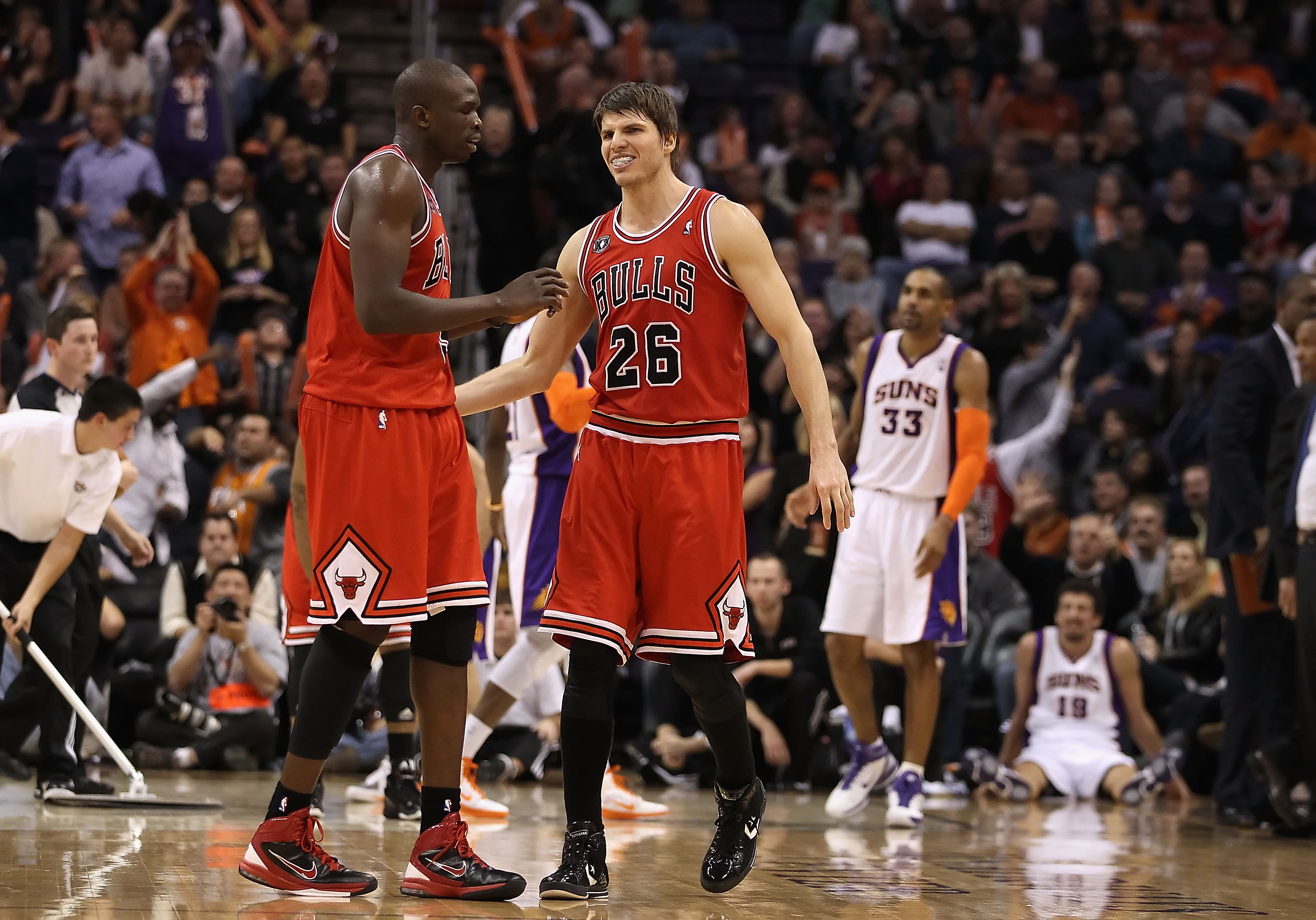 PHOENIX - NOVEMBER 24:  Luol Deng #9 and Kyle Korver #26 of the Chicago Bulls react after scoring against the Phoenix Suns late in overtime of the NBA game at US Airways Center on November 24, 2010 in Phoenix, Arizona. The Bulls defeated the Suns 123-115