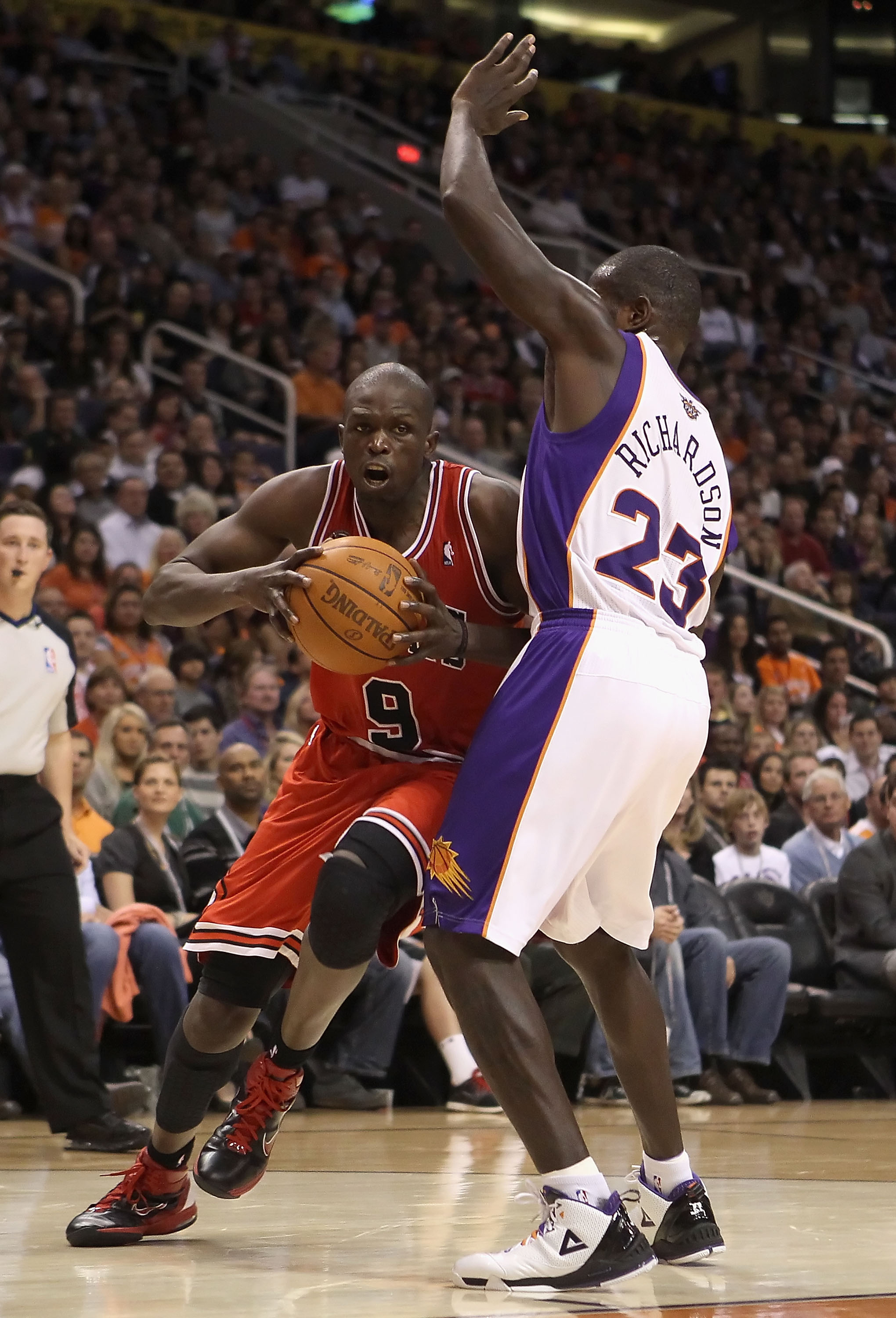 PHOENIX - NOVEMBER 24:  Luol Deng #9 of the Chicago Bulls drives to the basket during the NBA game against the Phoenix Suns at US Airways Center on November 24, 2010 in Phoenix, Arizona. The Bulls defeated the Suns 123-115 in double overtime.  NOTE TO USE