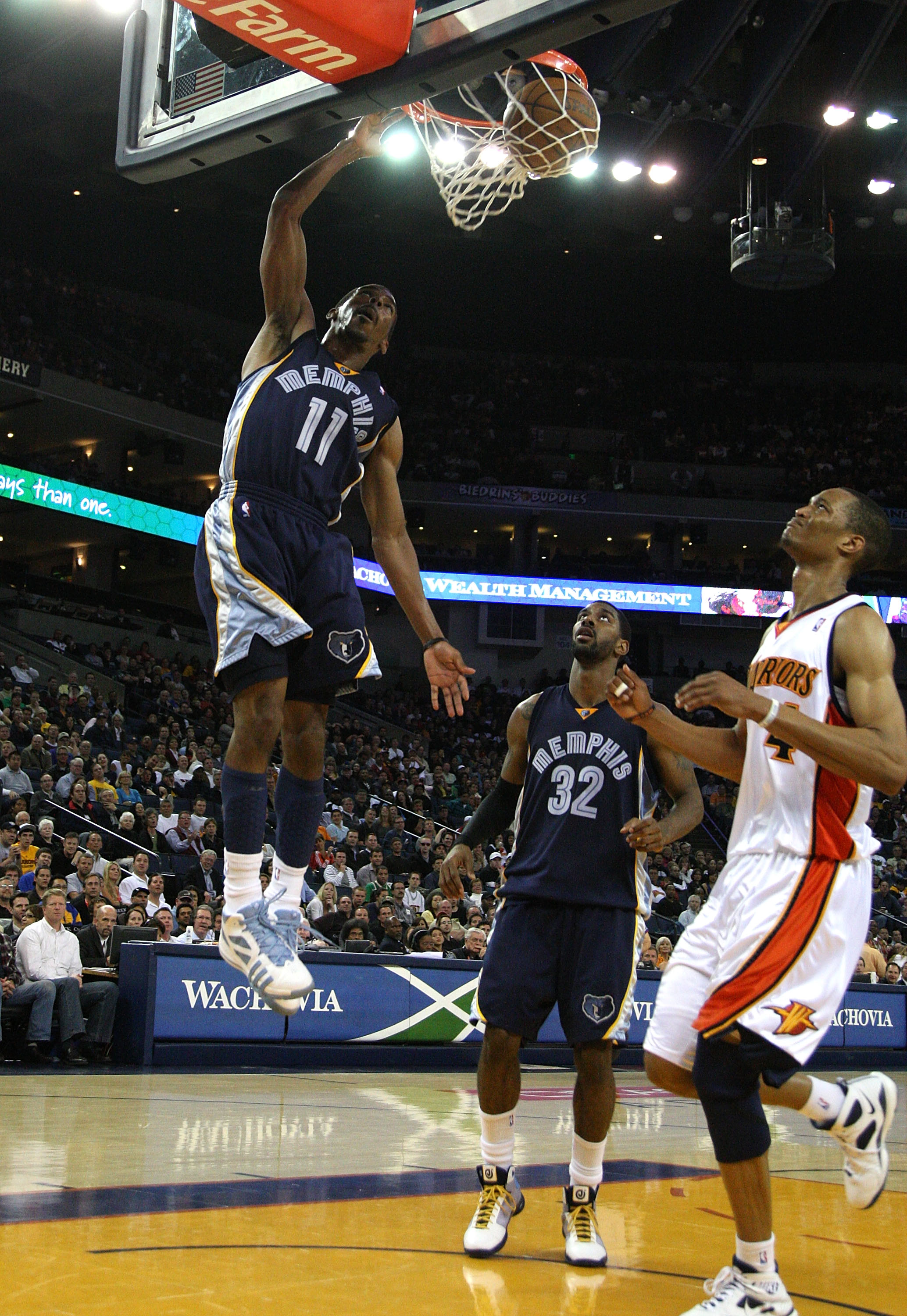 Anthony Randolph looks on as Mike Conley Jr. throws it down against the Warriors.