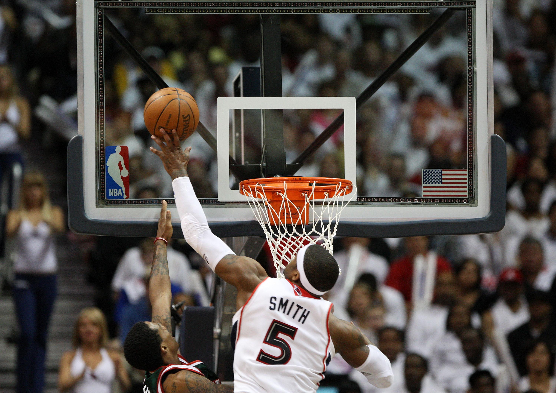 Josh Smith pins a shot against the Bucks.