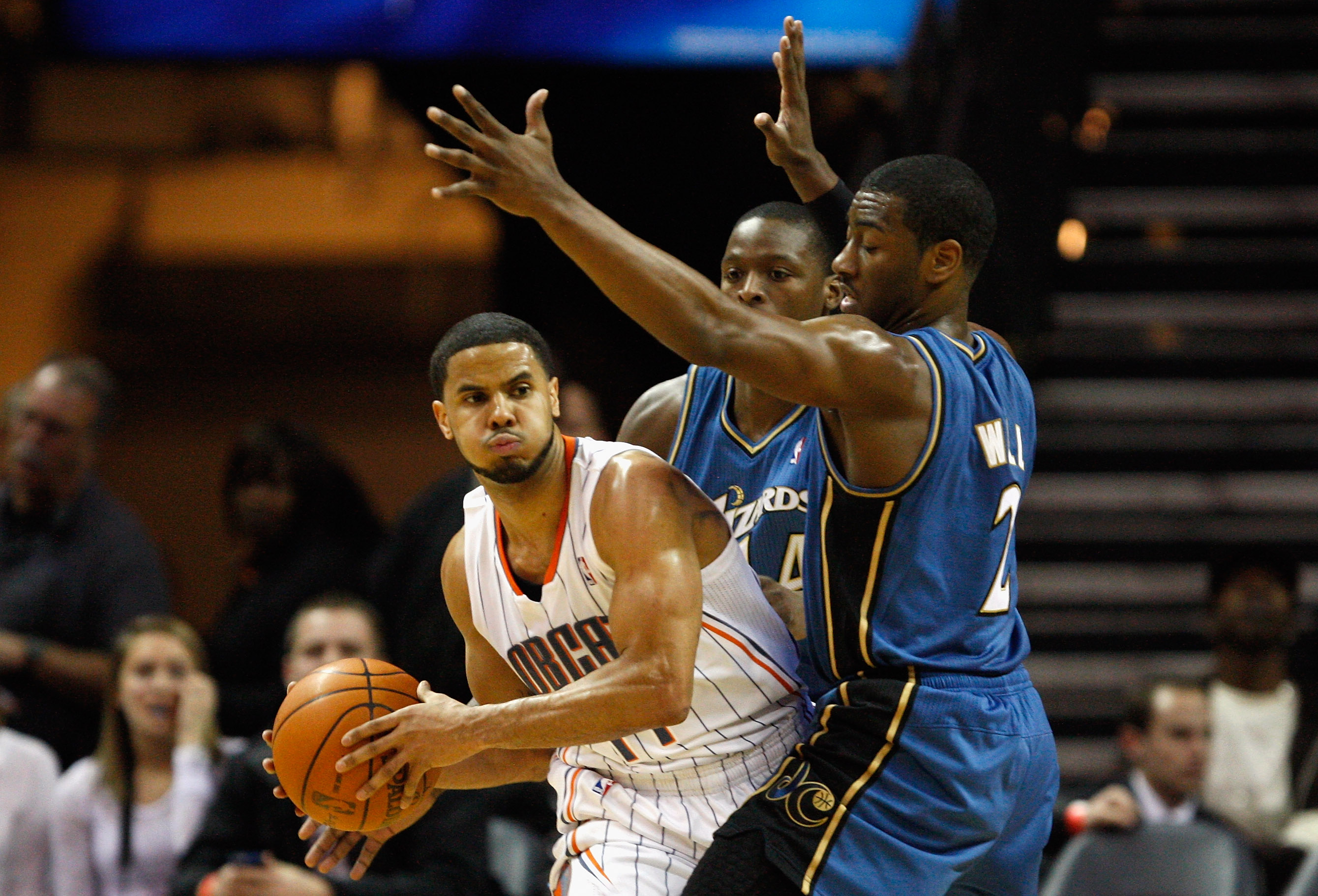 CHARLOTTE, NC - JANUARY 08:  Teammates John Wall #2 and Al Thornton #14 of the Washington Wizards trap D.J. Augustin #14 of the Charlotte Bobcats during their game at Time Warner Cable Arena on January 8, 2011 in Charlotte, North Carolina. NOTE TO USER: U