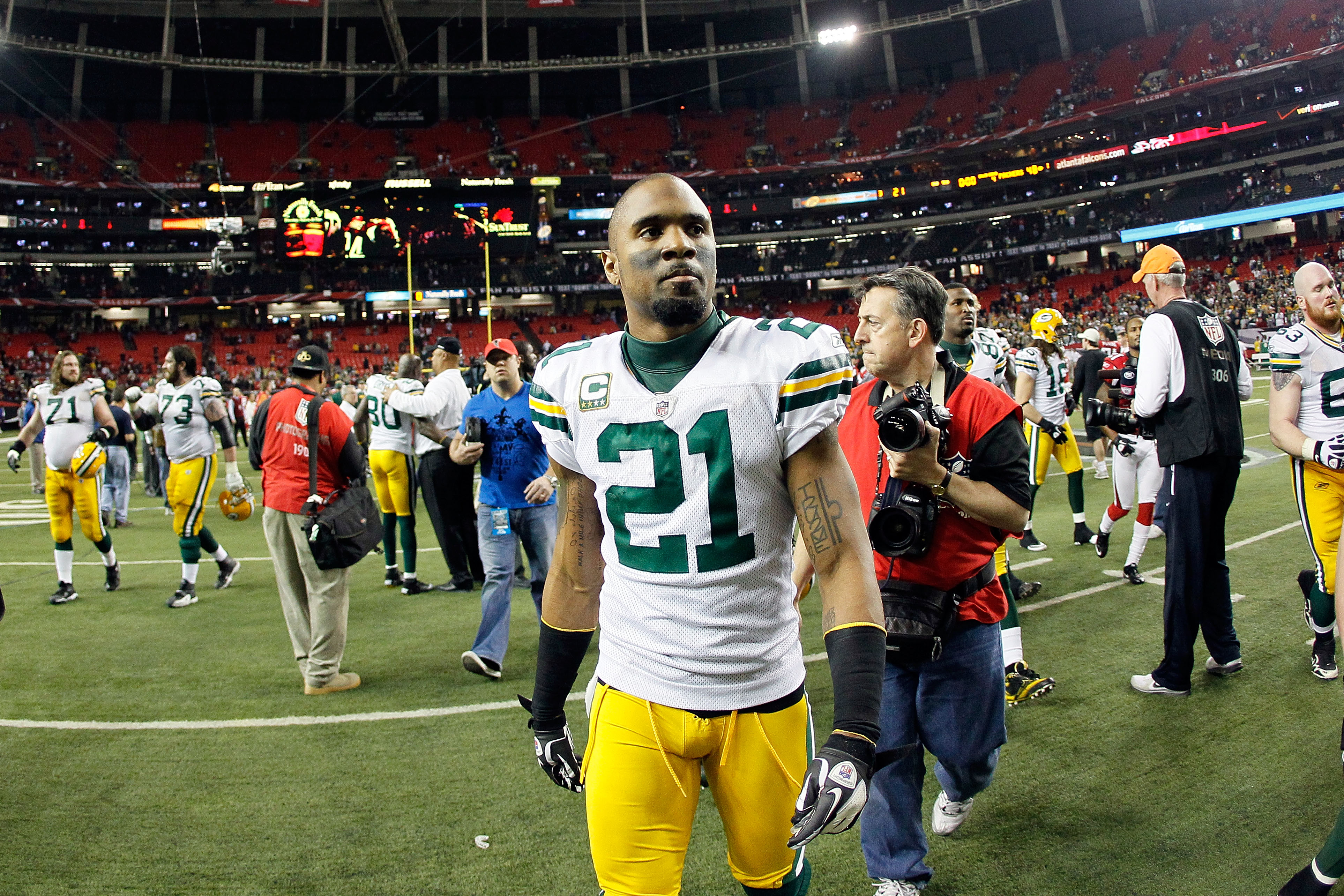 ATLANTA, GA - JANUARY 15:  Charles Woodson #21 of the Green Bay Packers walks off the field after they won 48-21 against the Atlanta Falcons during their 2011 NFC divisional playoff game at Georgia Dome on January 15, 2011 in Atlanta, Georgia.  (Photo by