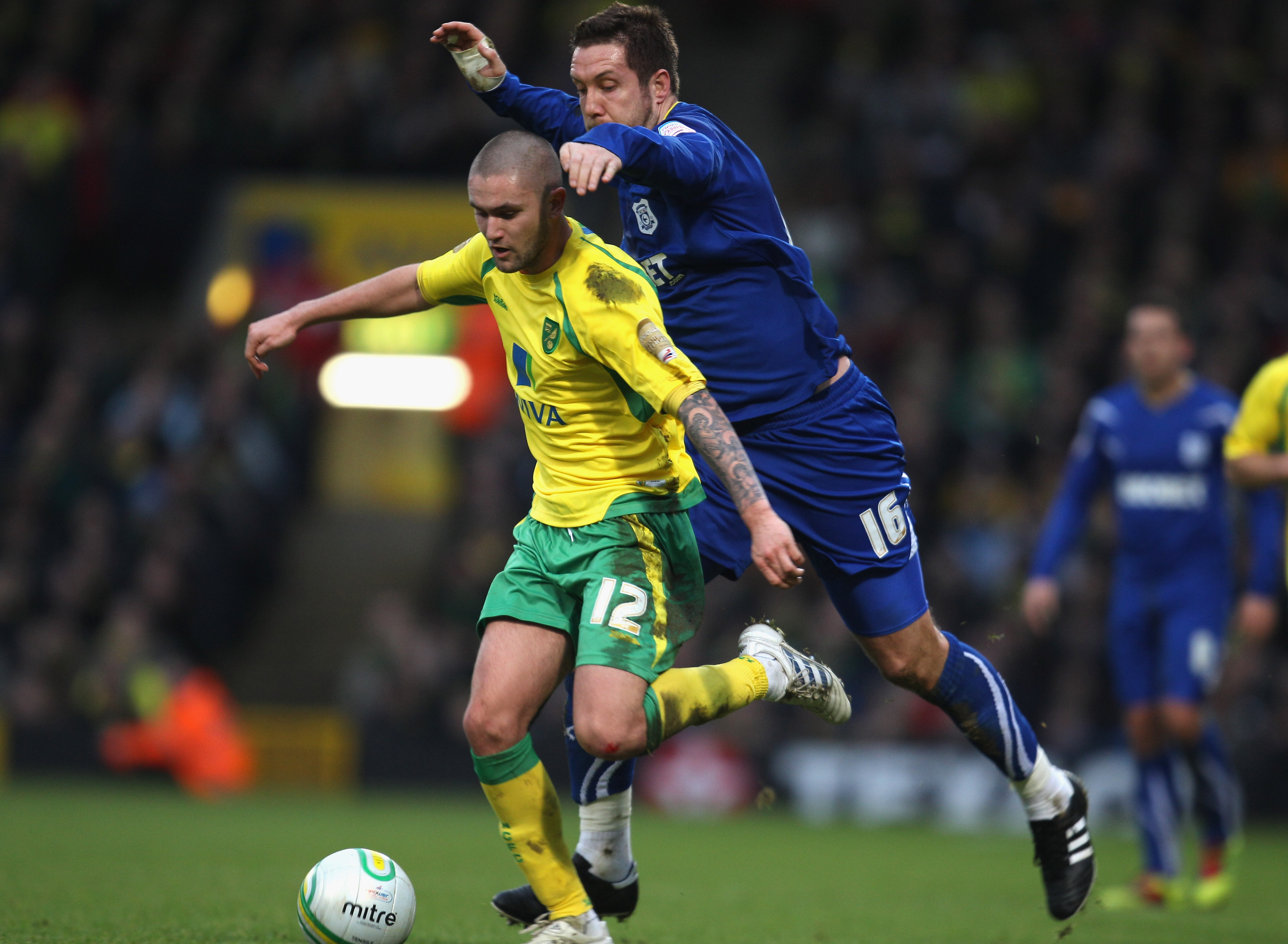 NORWICH, ENGLAND - JANUARY 15:   Henri Lansbury of Norwich City battes with Jon Parkin of Cardiff City during the npower Championship match between Norwich City and  Cardiff City at Carrow Road on January 15, 2011 in Norwich, England.  (Photo by Mark Thom