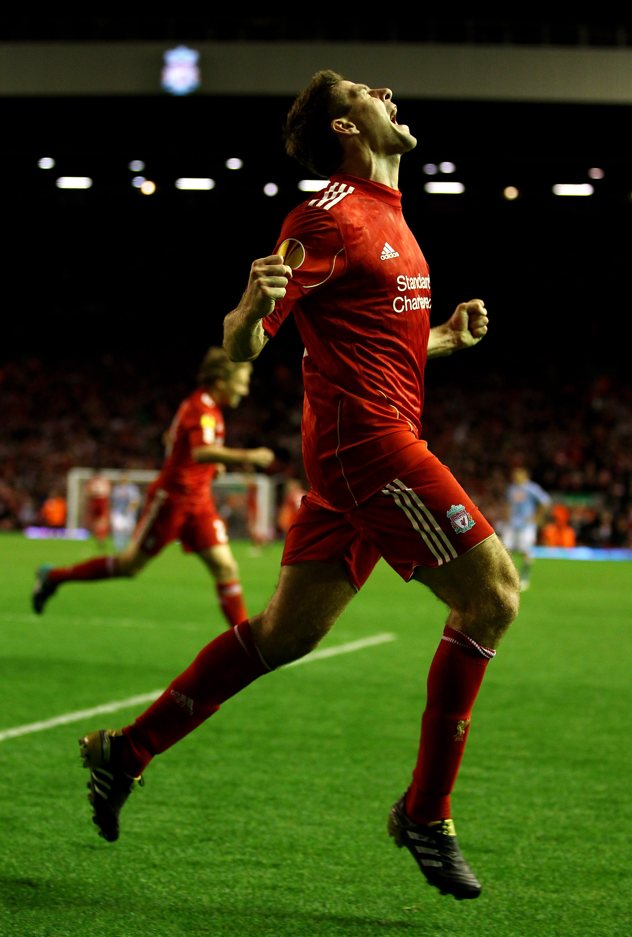 LIVERPOOL, ENGLAND - NOVEMBER 04:  Steven Gerrard of Liverpool celebrates scoring his team's third goal and his hat trick during the UEFA Europa League Group K match beteween Liverpool and SSC Napoli at Anfield on November 4, 2010 in Liverpool, England.