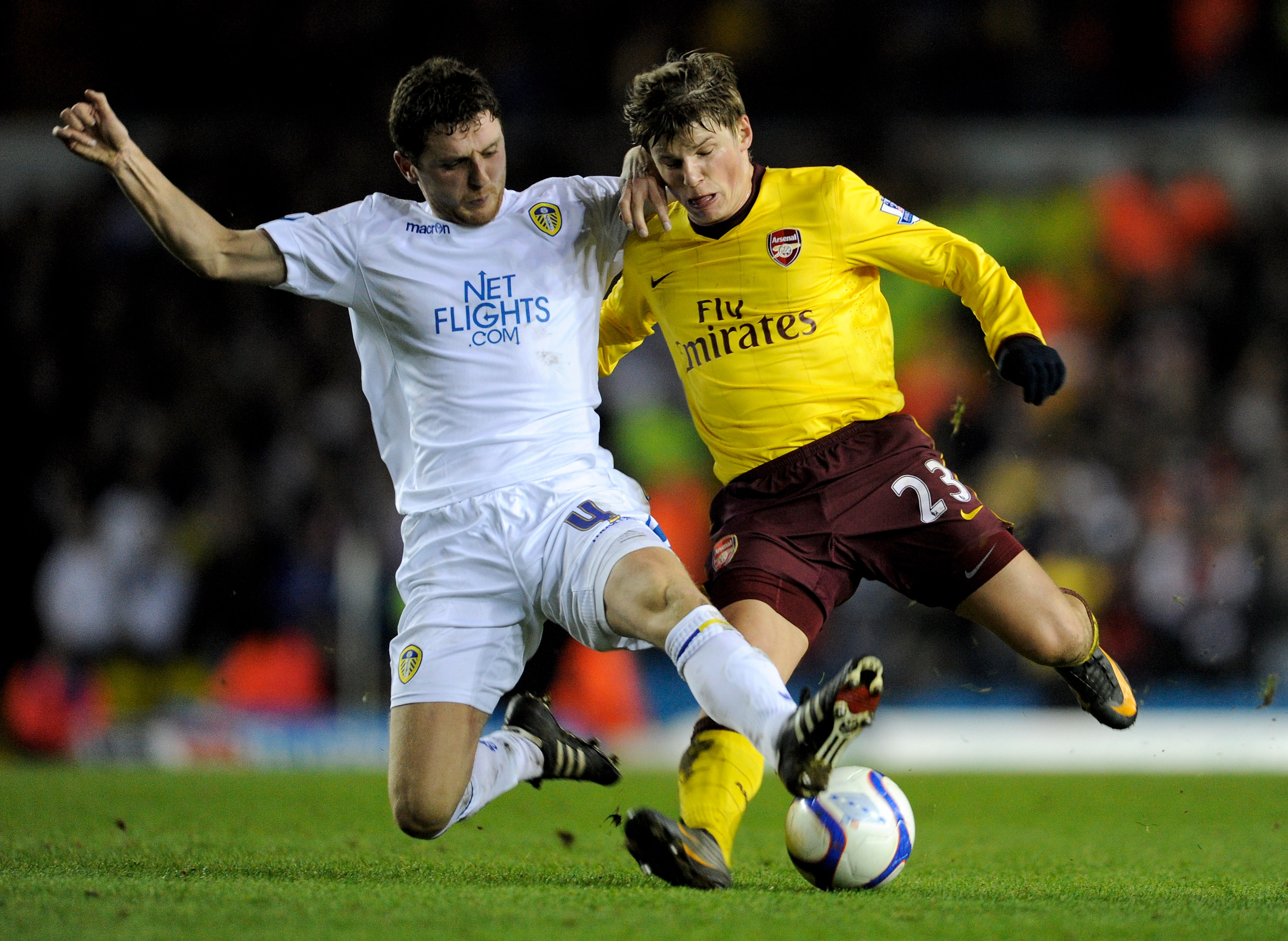 LEEDS, ENGLAND - JANUARY 19: Alex Bruce of Leeds United challenges Andrey Arshavin of Arsenal during the FA Cup sponsored by E.On Third Round Replay match between Leeds United and Arsenal at Elland Road on January 19, 2011 in Leeds, England. (Photo by Mic