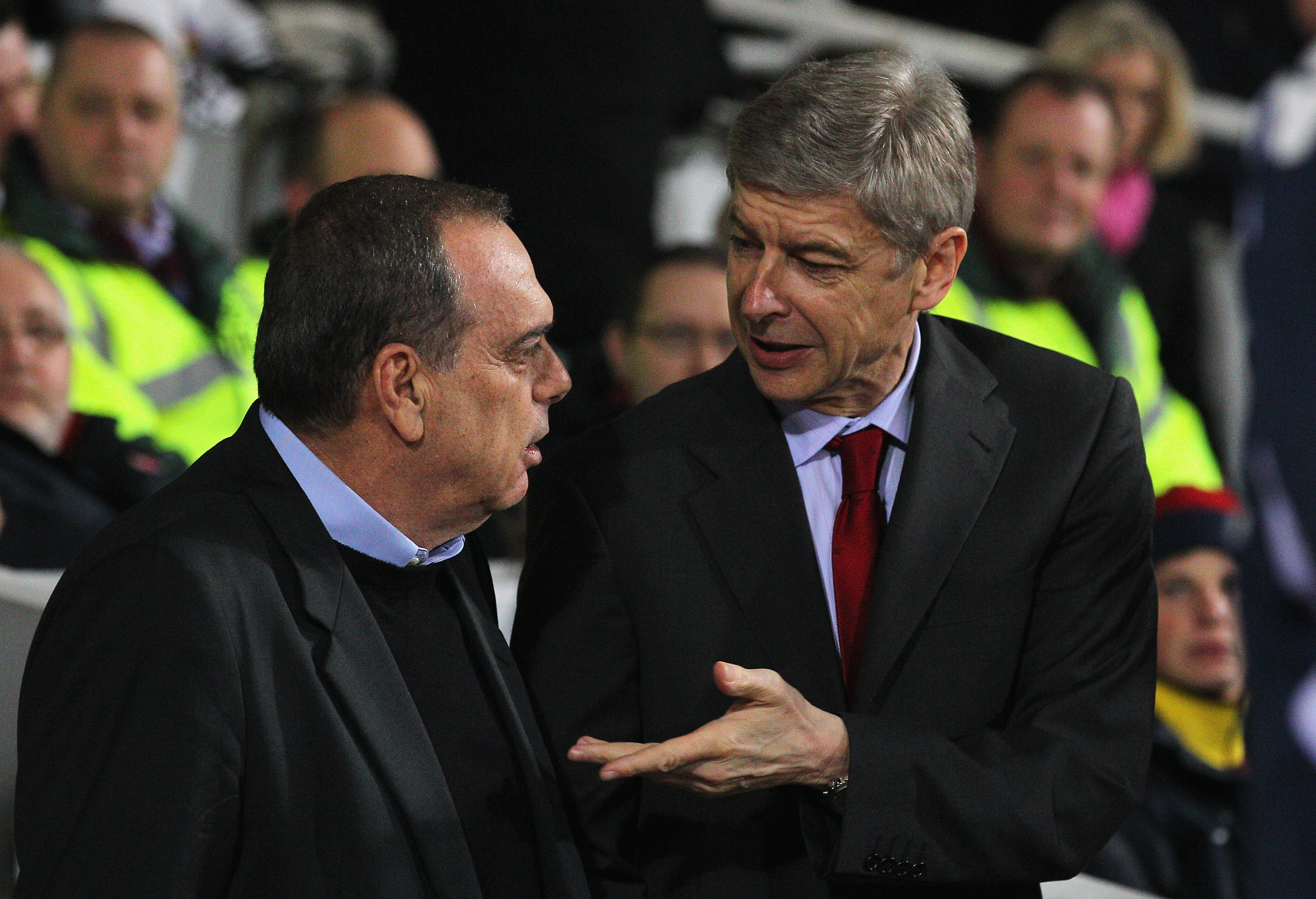 LONDON, ENGLAND - JANUARY 15:  Avram Grant (L), manager of West Ham United talks to Arsene Wenger, Manager of Arsenal ahead of the Barclays Premier League match between West Ham United and Arsenal at the Boleyn Ground on January 15, 2011 in London, Englan