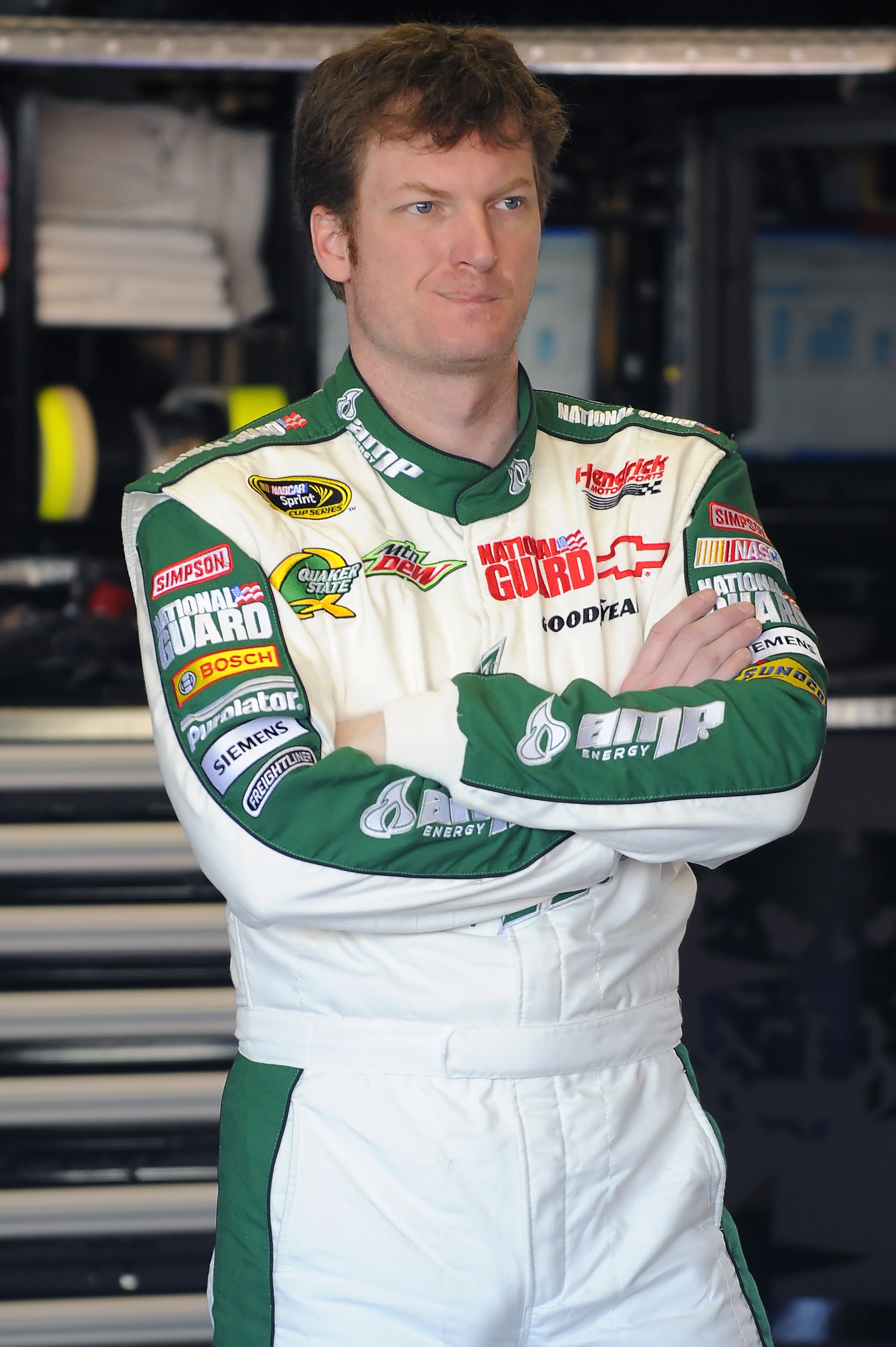 DAYTONA BEACH, FL - JANUARY 20:  Dale Earnhardt Jr., driver of the #88 AMP Energy Chevrolet, waits to continue testing at Daytona International Speedway on January 20, 2011 in Daytona Beach, Florida.  (Photo by Jared C. Tilton/Getty Images for NASCAR)