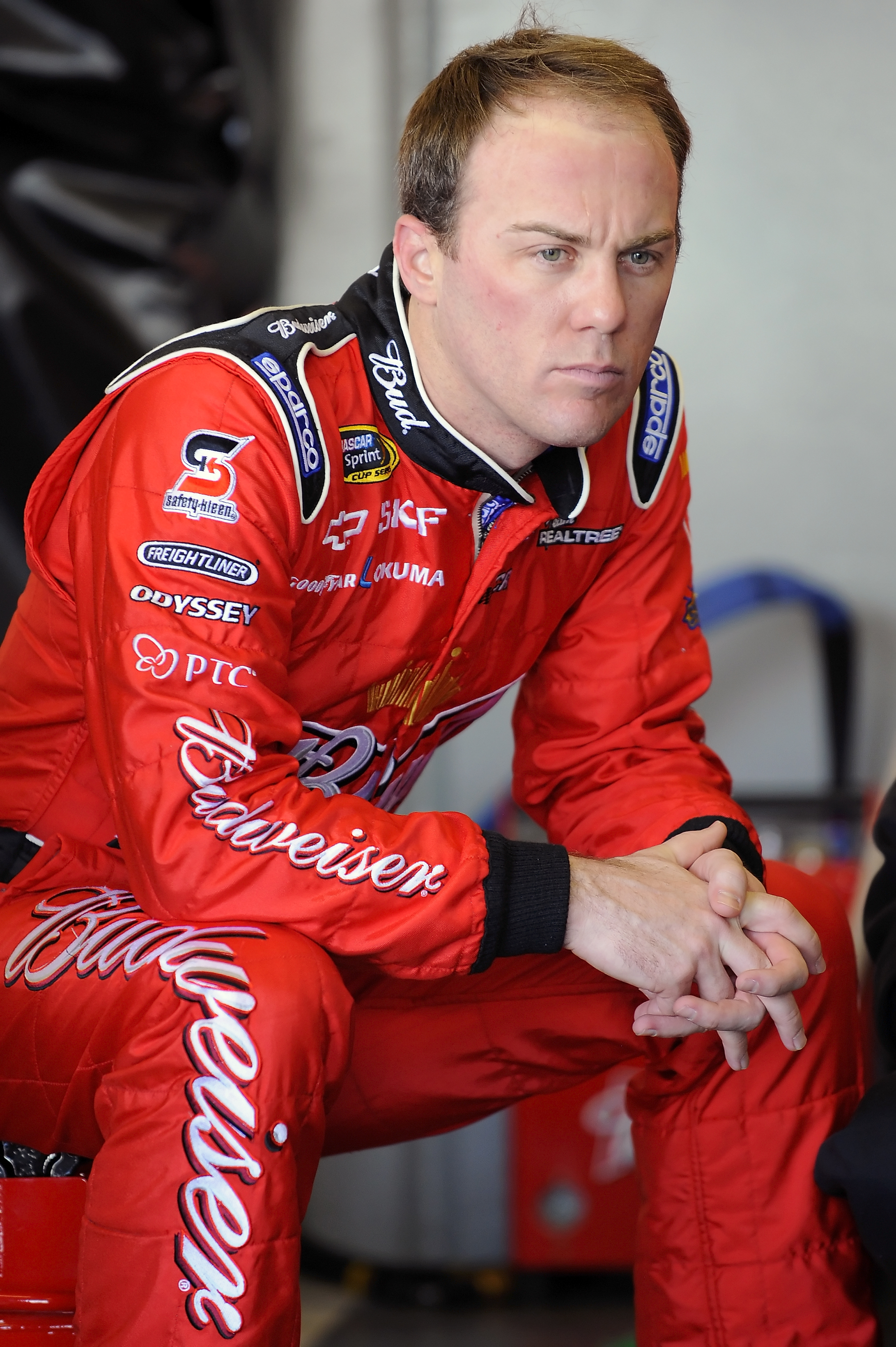 DAYTONA BEACH, FL - JANUARY 20:  Kevin Harvick, driver of the #29 Budweiser Chevrolet, waits in the garage during a test session at Daytona International Speedway on January 20, 2011 in Daytona Beach, Florida.  (Photo by Jared C. Tilton/Getty Images for N