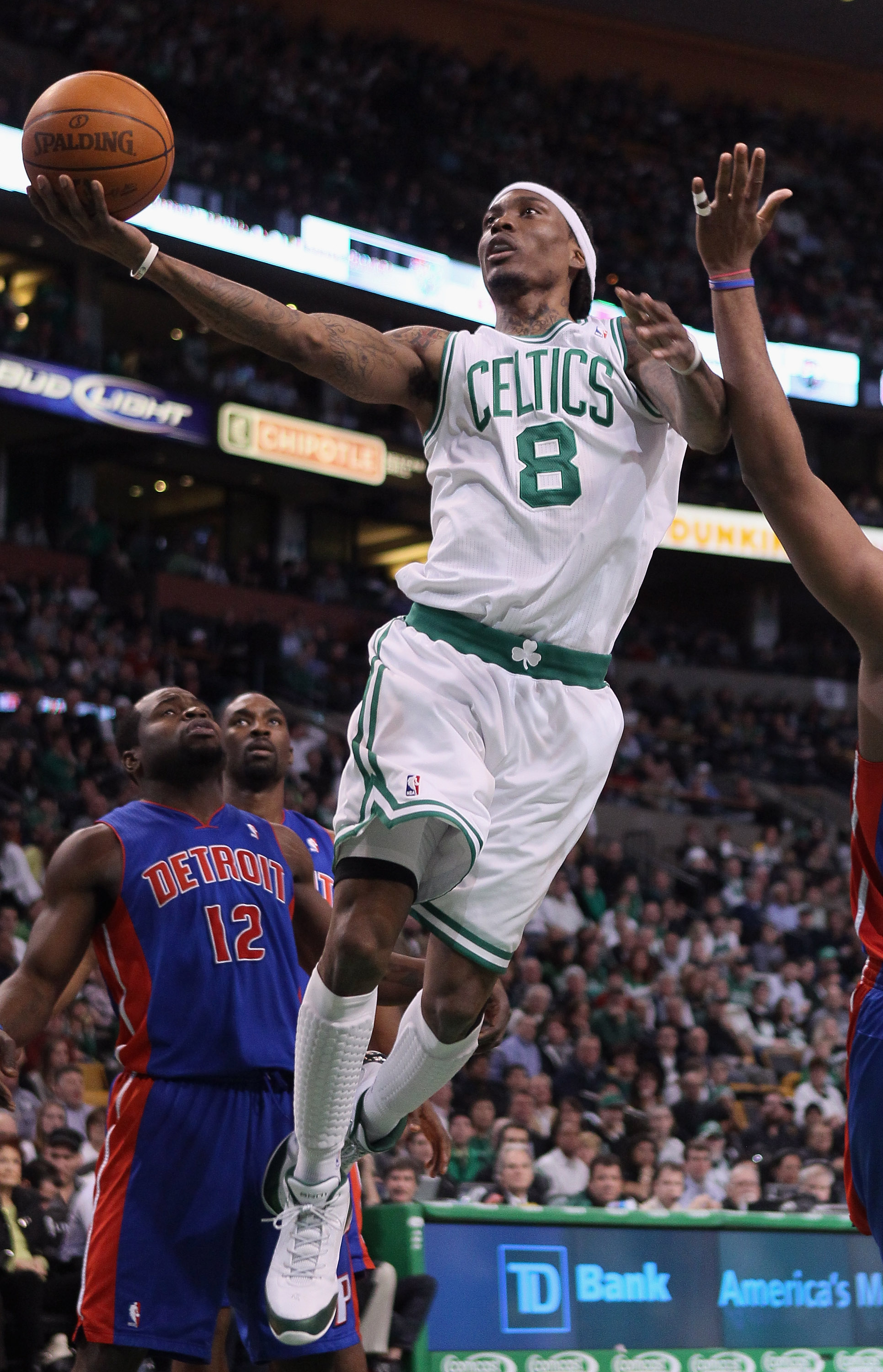 BOSTON, MA - JANUARY 19:  Marquis Daniels #8 of the Boston Celtics goes up for a shot as Will Bynum #12 of the Detroit Pistons defends on January 19, 2011 at the TD Garden in Boston, Massachusetts.  NOTE TO USER: User expressly acknowledges and agrees tha