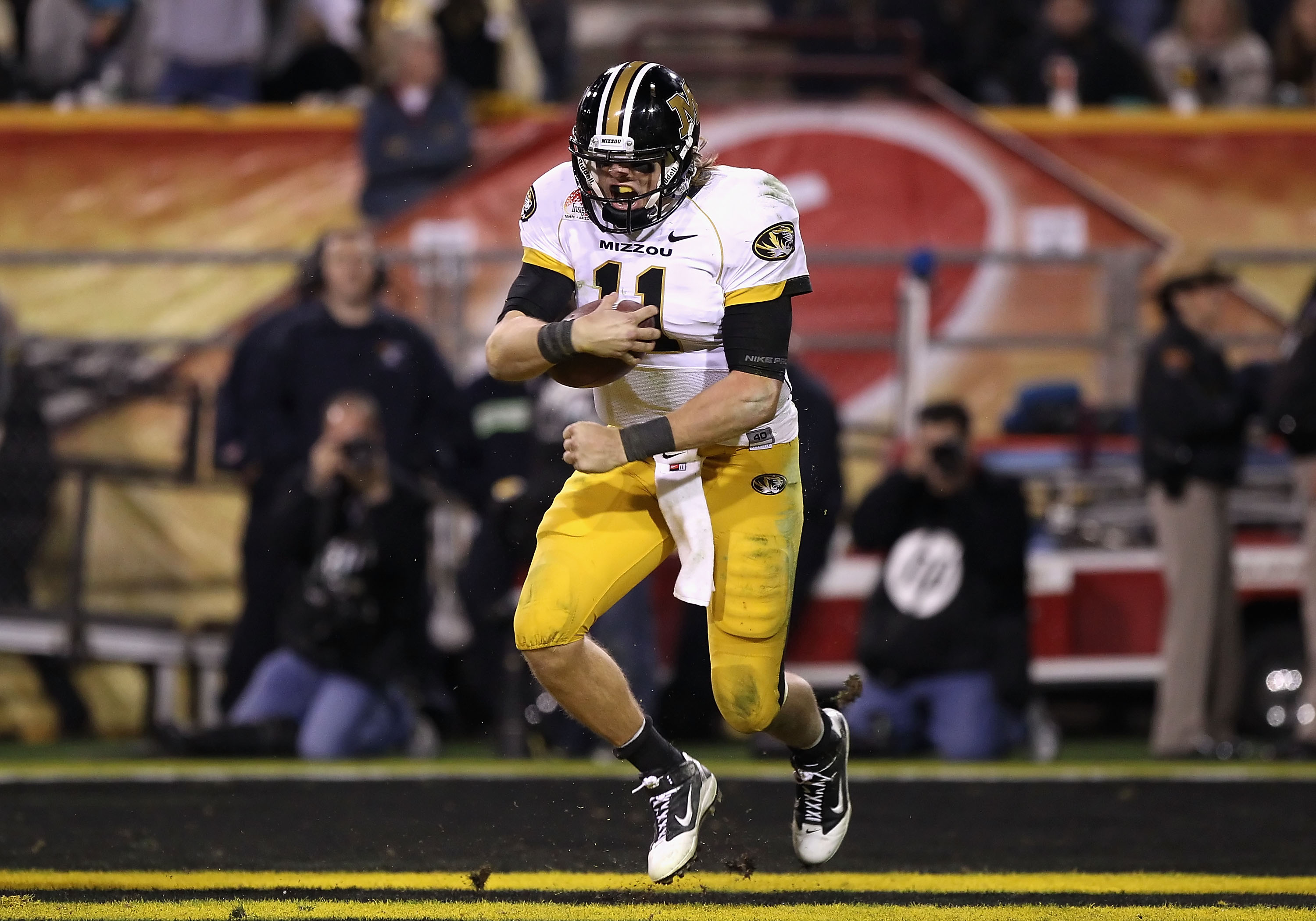 TEMPE, AZ - DECEMBER 28:  Quarterback Blaine Gabbert #11 of the Missouri Tigers celebrates after scoring a 7 yard rushing touchdown against the Iowa Hawkeyes during the third quarter of the Insight Bowl at Sun Devil Stadium on December 28, 2010 in Tempe,