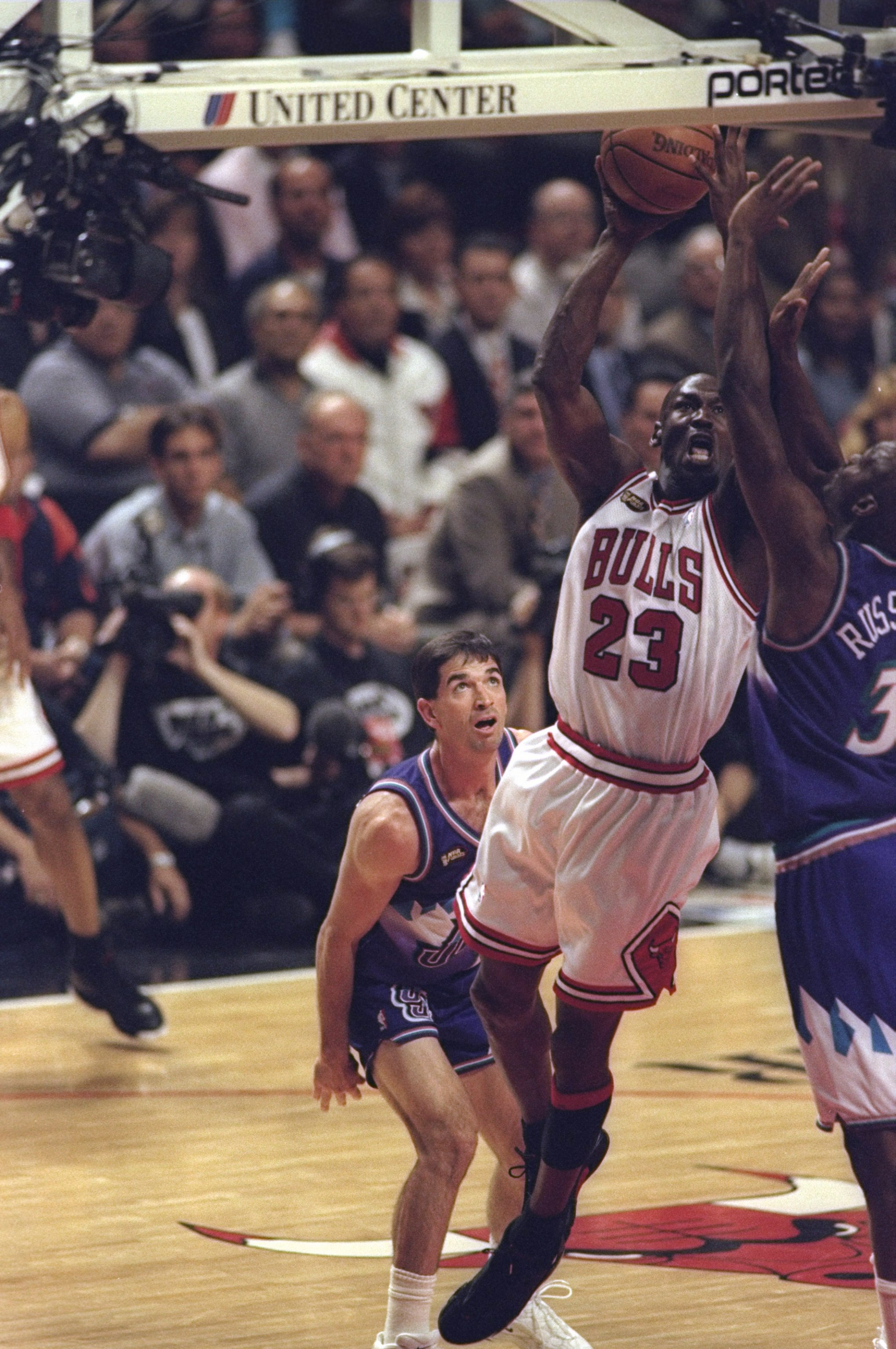 10 Jun 1998:  Michael Jordan #23 of the Chicago Bulls in action against John Stockton #12 and Bryon Russell #3 of the Utah Jazz during the NBA Finals Game 4 at the United Center in Chicago, Illinois.  The Bulls defeated the Jazz 86-82. Mandatory Credit: M