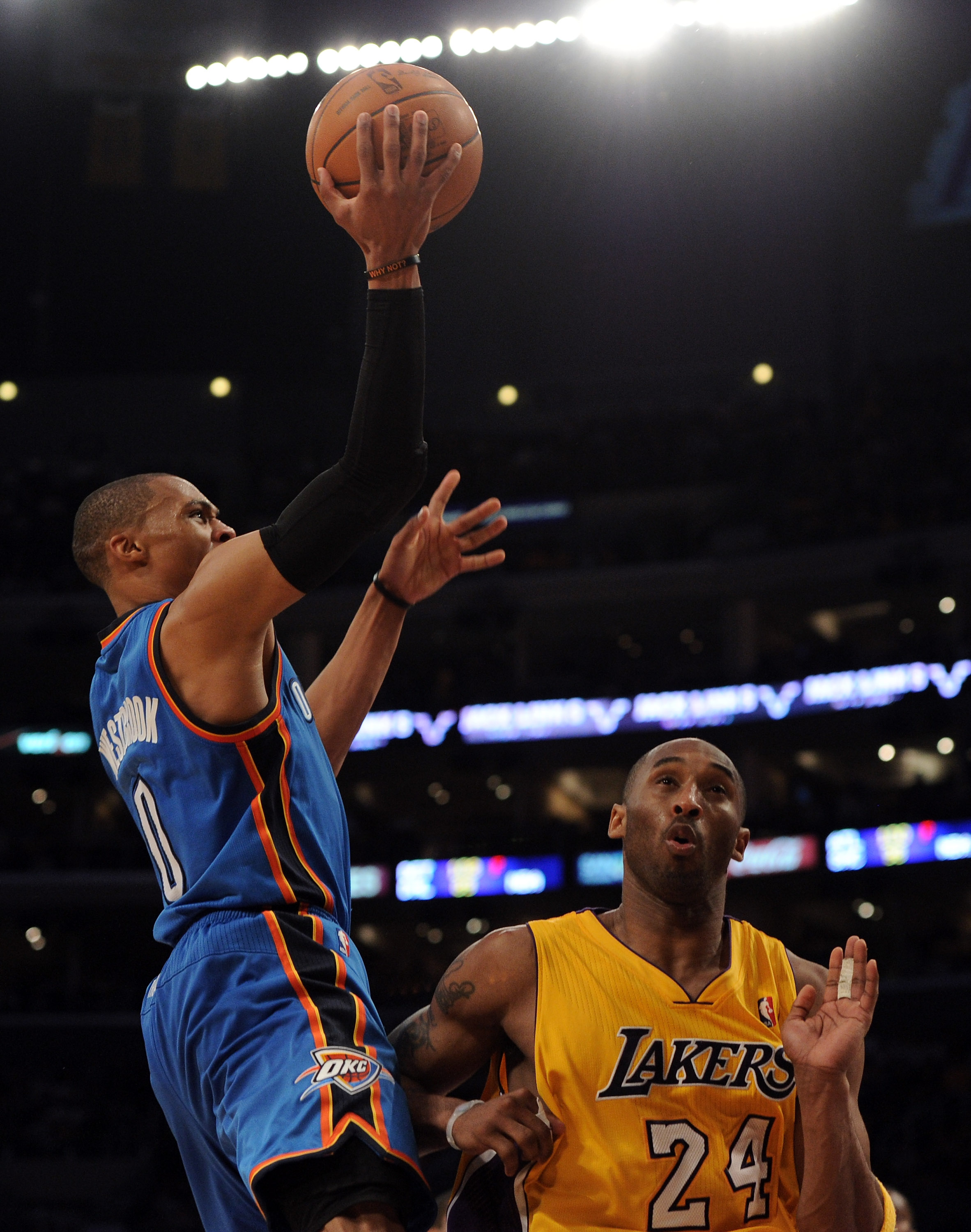 LOS ANGELES, CA - JANUARY 17:  Russell Westbrook #0 of the Oklahoma City Thunder goes in for a layup in front of Kobe Bryant #24 of the Los Angeles Lakers during a 101-94 Laker win at the Staples Center on January 17, 2011 in Los Angeles, California.   NO
