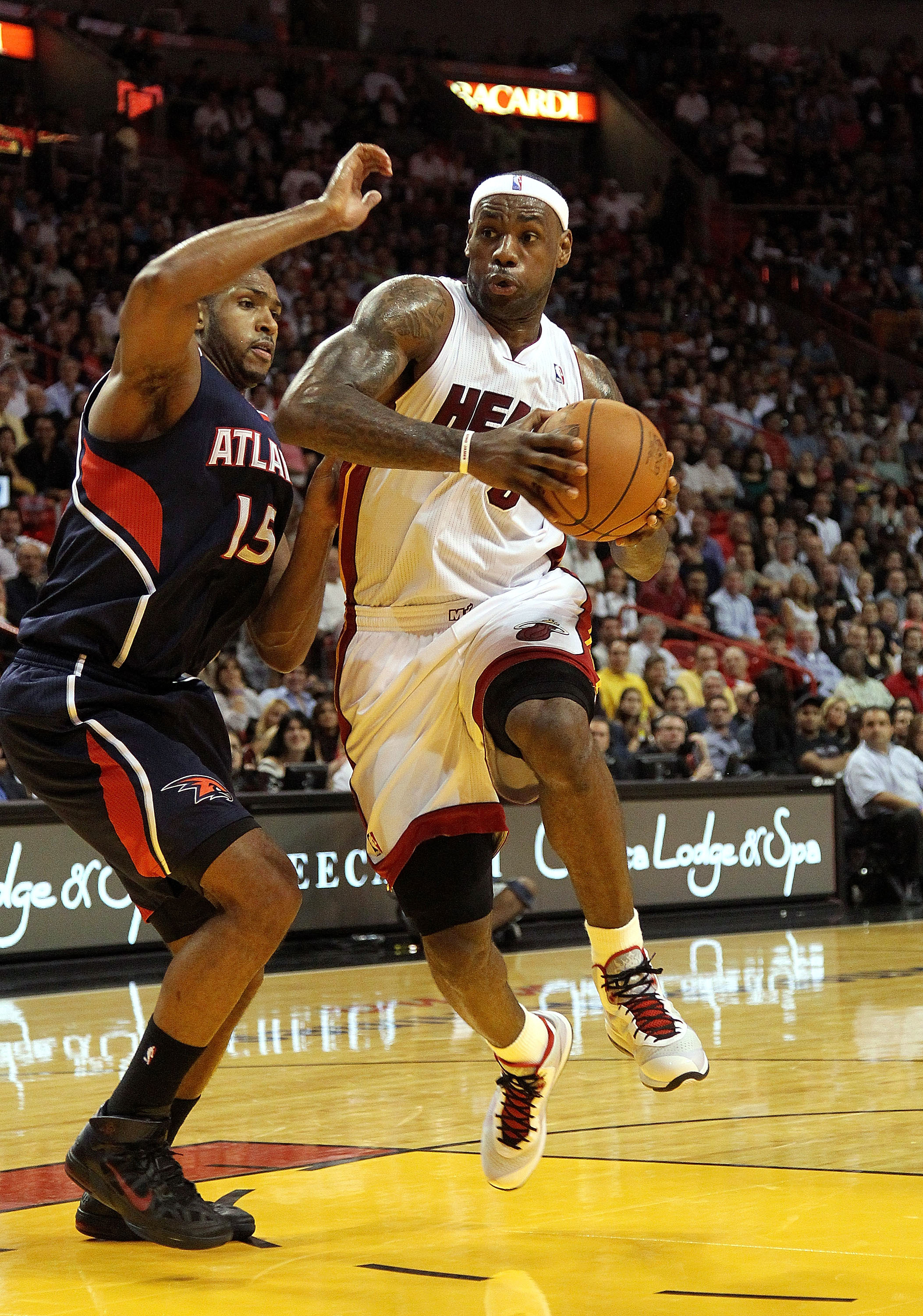 MIAMI, FL - JANUARY 18:  LeBron James #6 of the Miami Heat is guarded by Al Horford #15 of the Atlanta Hawks during a game at American Airlines Arena on January 18, 2011 in Miami, Florida. NOTE TO USER: User expressly acknowledges and agrees that, by down