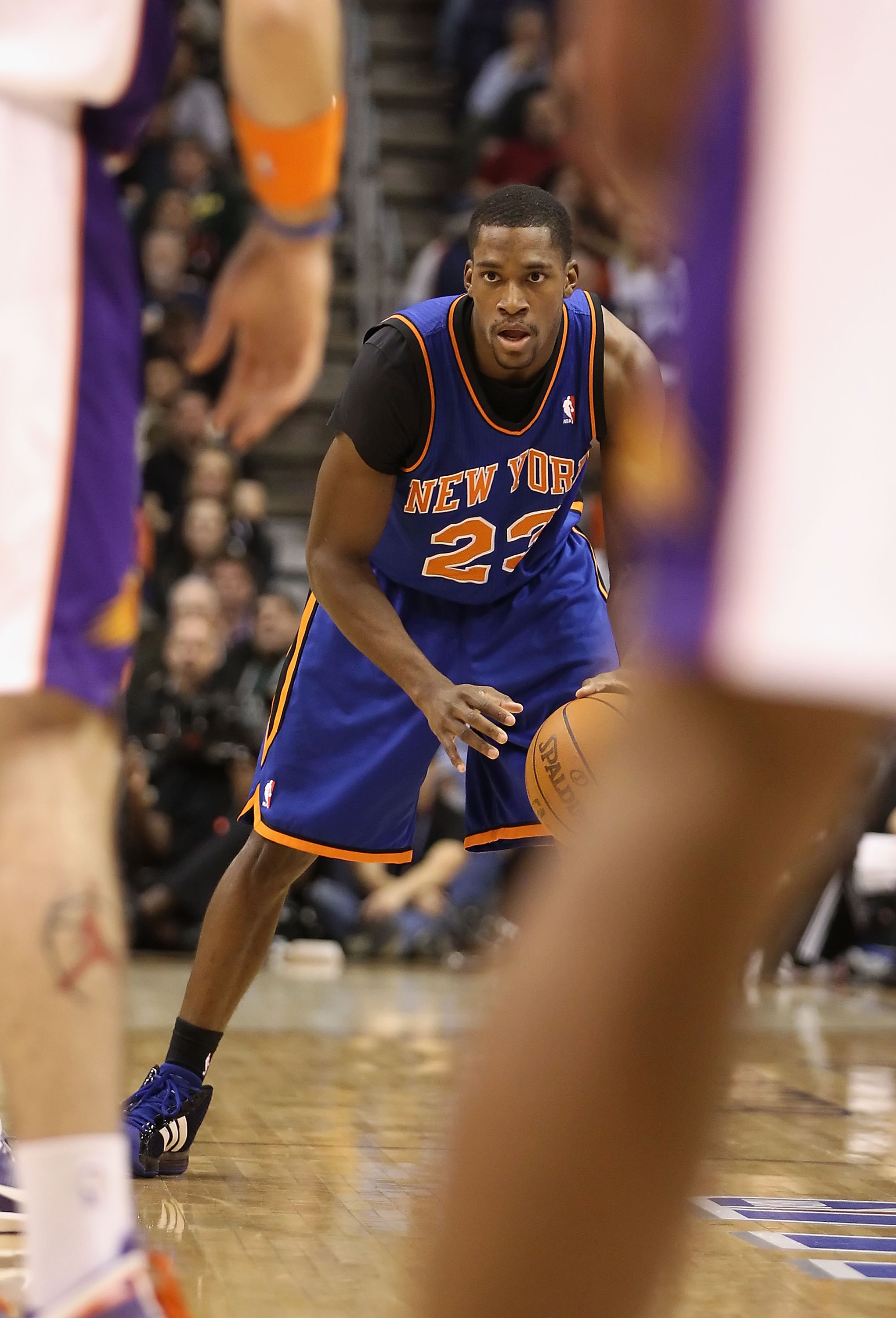PHOENIX, AZ - JANUARY 07:  Toney Douglas #23 of the New York Knicks handles the ball during the NBA game against the Phoenix Suns at US Airways Center on January 7, 2011 in Phoenix, Arizona.  NOTE TO USER: User expressly acknowledges and agrees that, by d