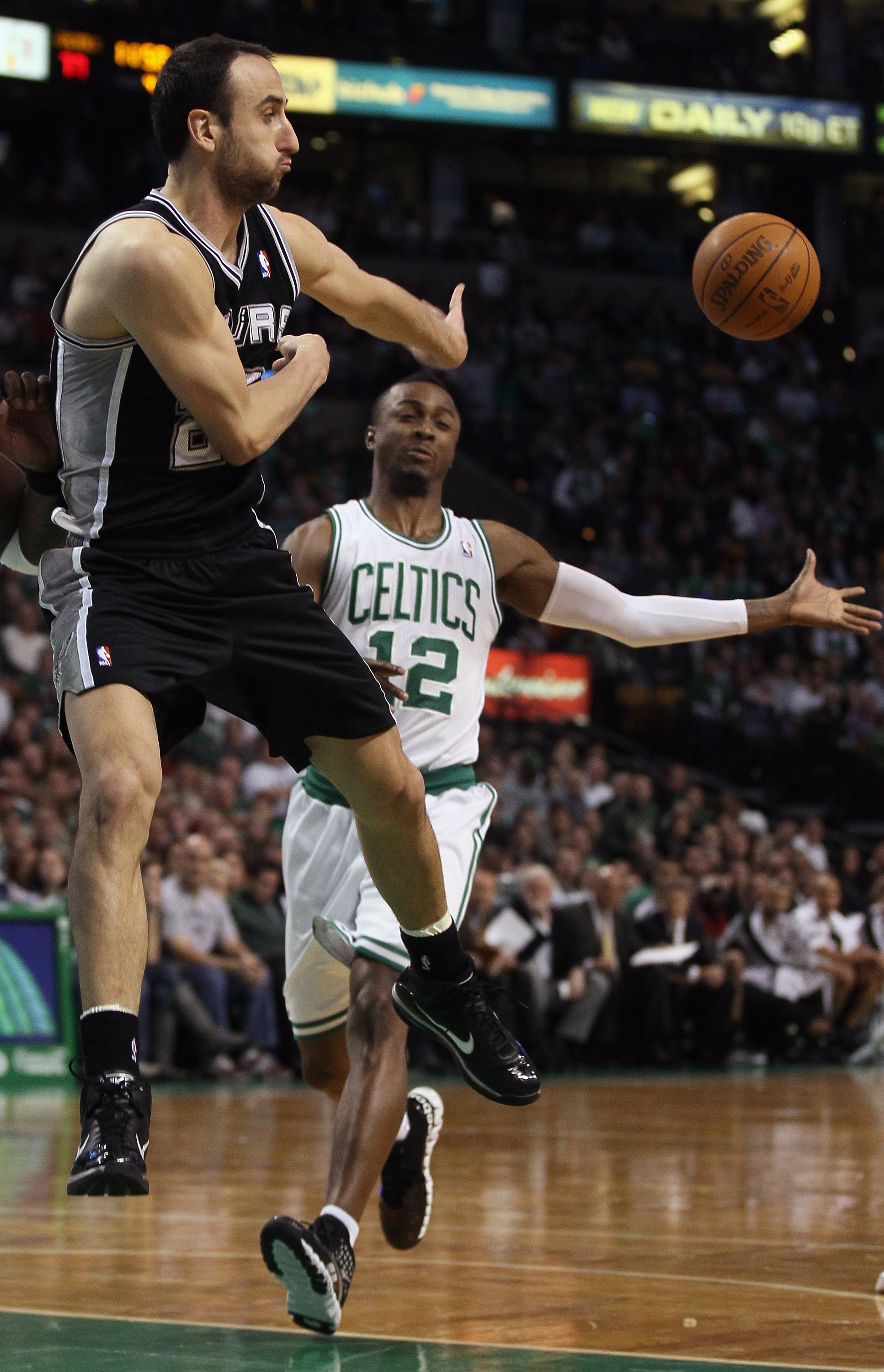 BOSTON, MA - JANUARY 05:  Manu Ginobili #20 of the San Antonio Spurs passes the ball as Von Wafer #12 of the Boston Celtics defends on January 5, 2011 at the TD Garden in Boston, Massachusetts. The Celtics defeated the Spurs 105-103. NOTE TO USER: User ex