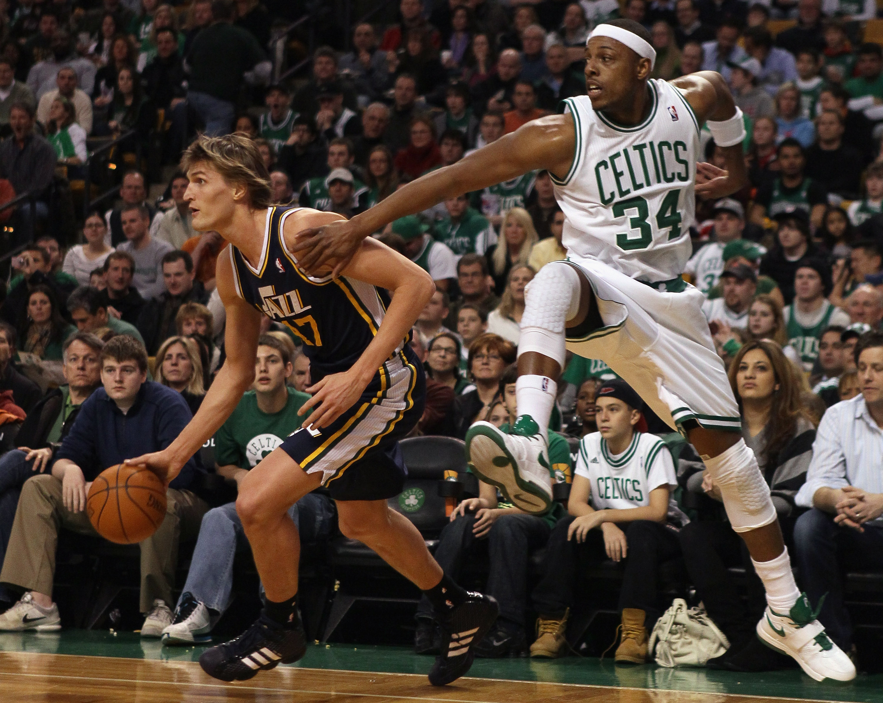 BOSTON, MA - JANUARY 21:  Andrei Kirilenko #47 of the Utah Jazz tries to keep the ball as Paul Pierce #34 of the Boston Celtics jumps to block on January 21, 2011 at the TD Garden in Boston, Massachusetts.  NOTE TO USER: User expressly acknowledges and ag